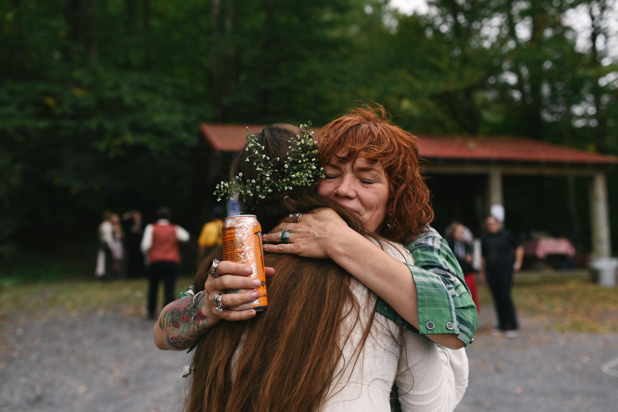 Mountain Wedding, Outdoors, Rustic, West Virginia, Maryland Wedding Photographer, DIY, Casual, Guest hugging bride at reception