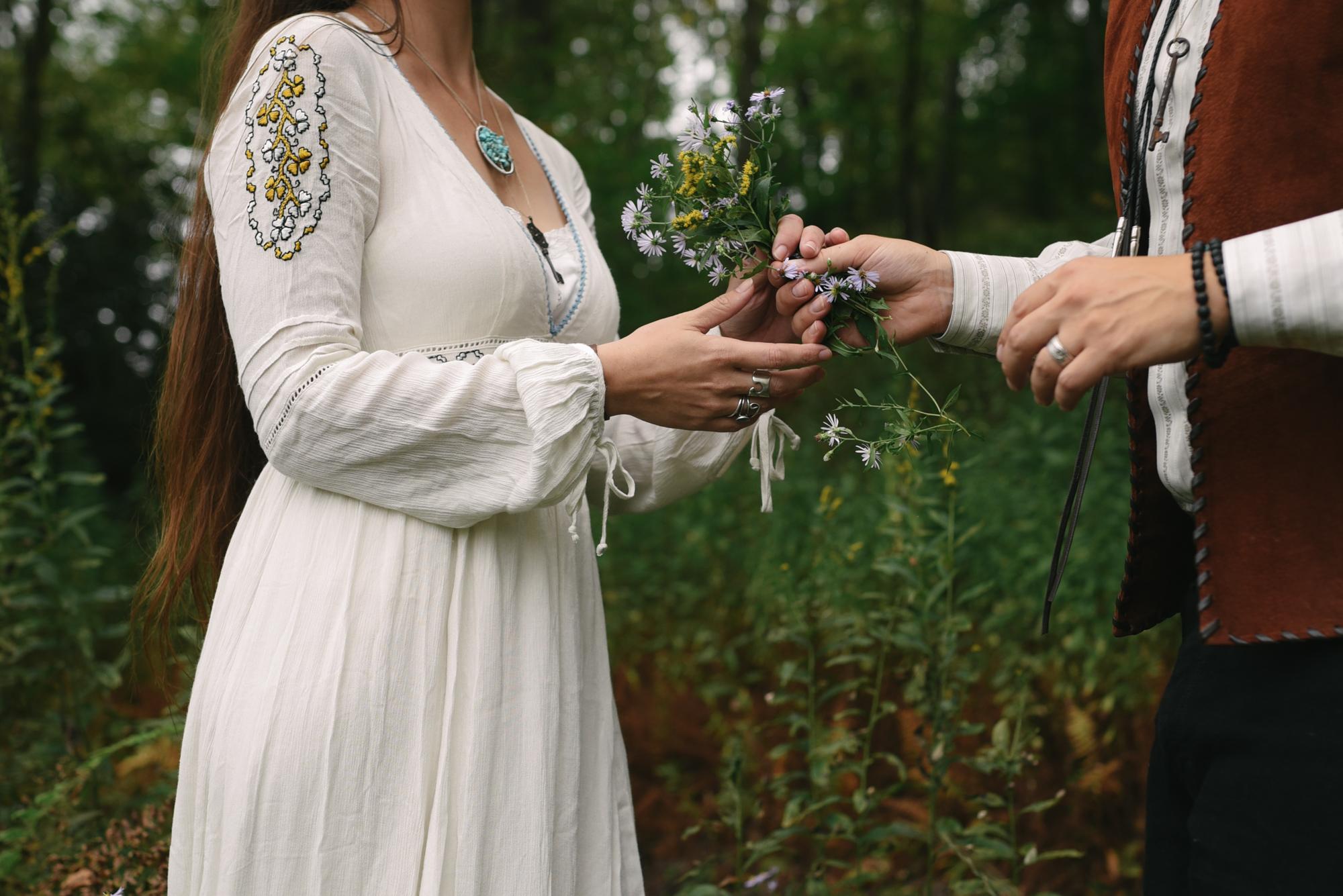 Mountain Wedding, Outdoors, Rustic, West Virginia, Maryland Wedding Photographer, DIY, Casual, sweet photo of groom giving bride wildflowers