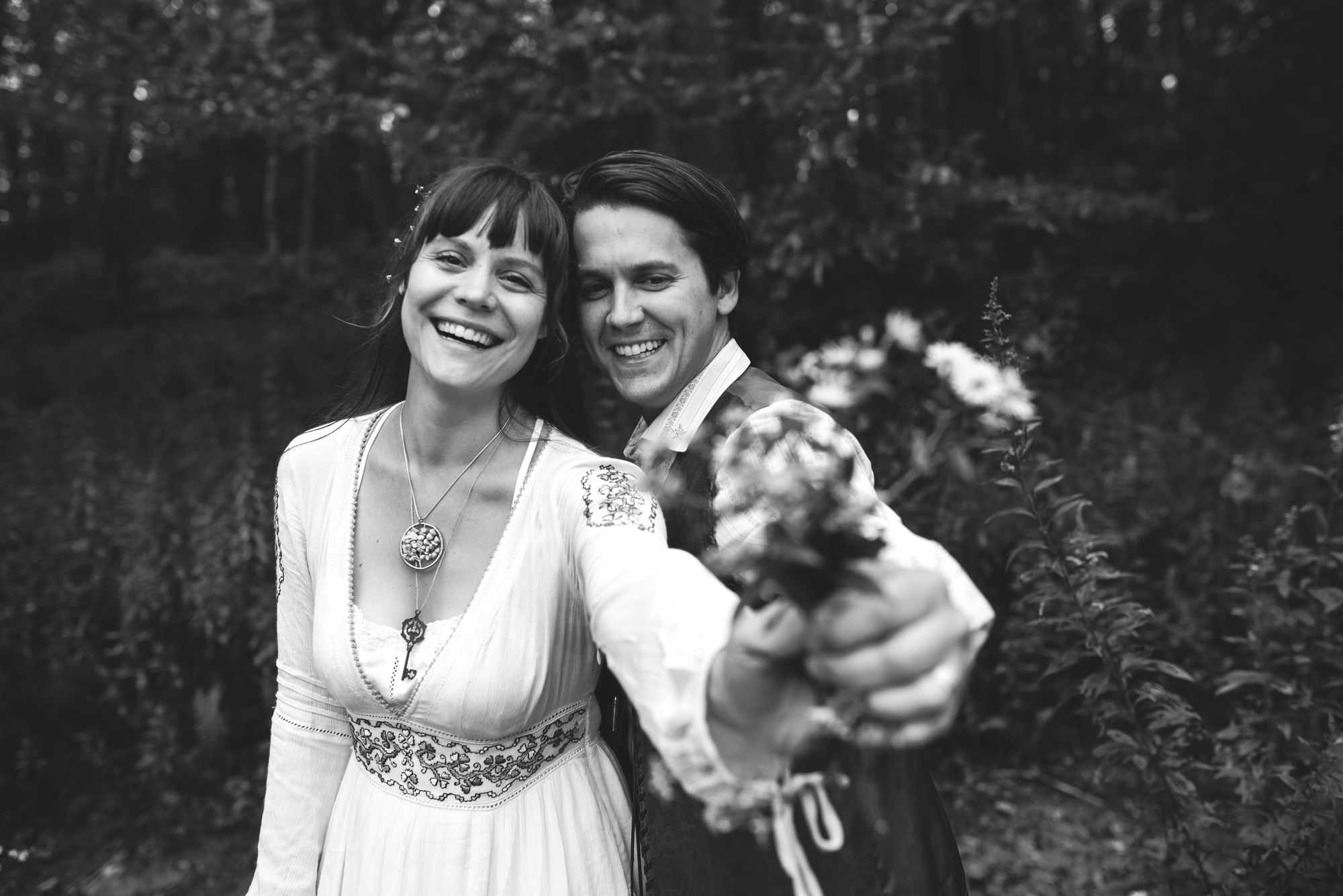 Mountain Wedding, Outdoors, Rustic, West Virginia, Maryland Wedding Photographer, DIY, Casual, black and white photo, bride and groom smiling and holding wildflowers
