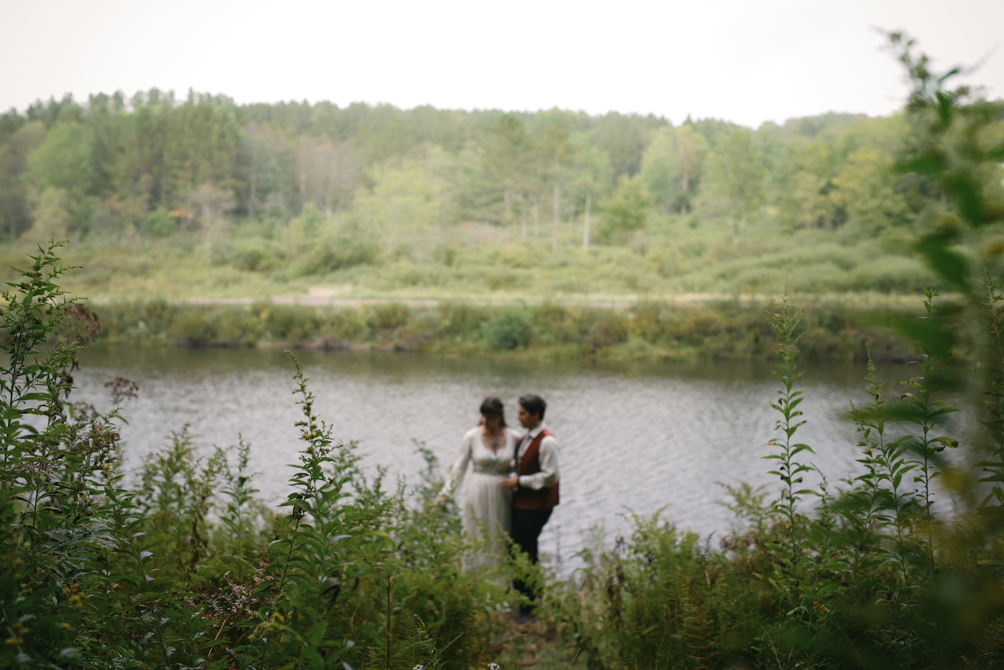 Mountain Wedding, Outdoors, Rustic, West Virginia, Maryland Wedding Photographer, DIY, Casual, candid photo of bride and groom alongside river