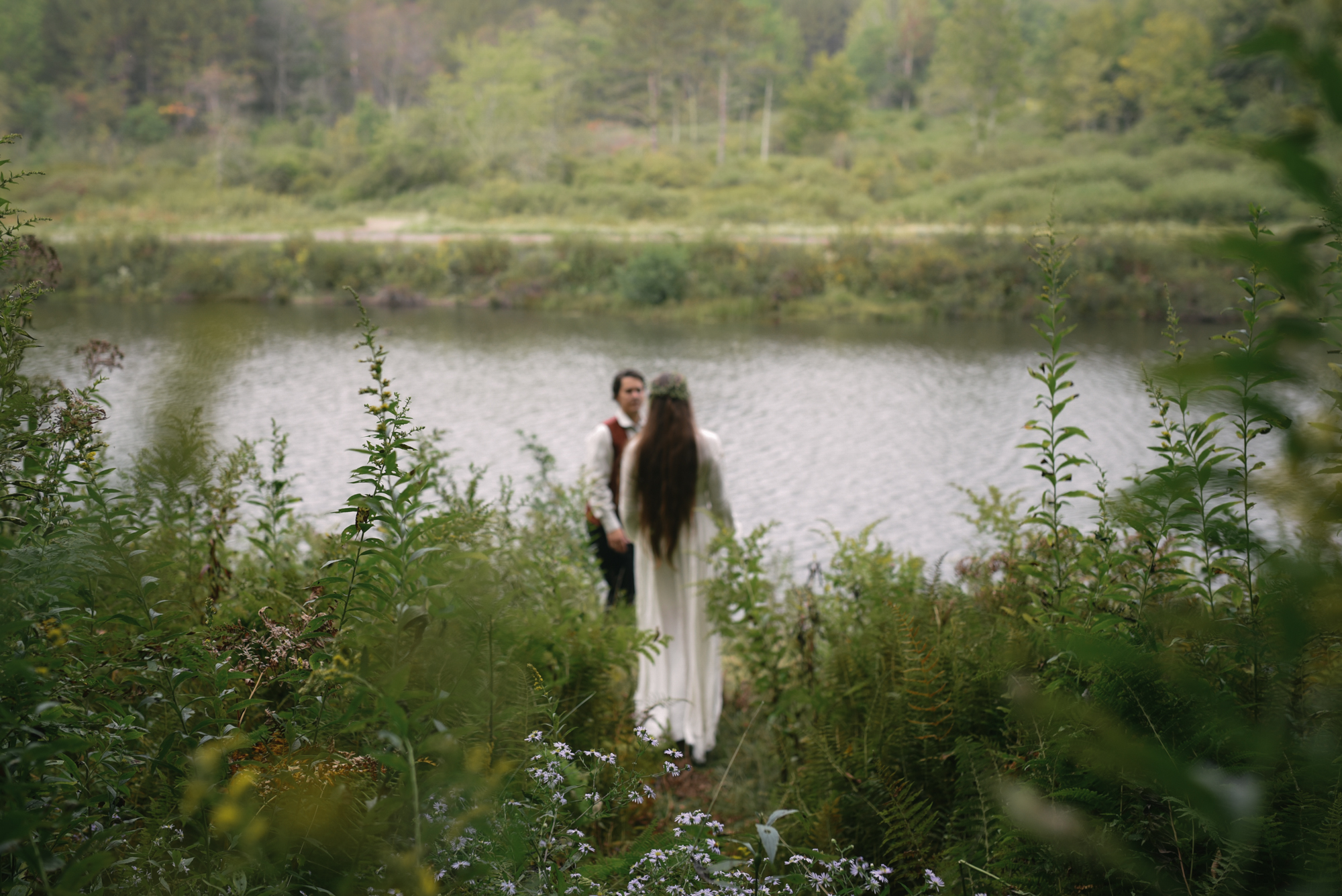 Mountain Wedding, Outdoors, Rustic, West Virginia, Maryland Wedding Photographer, DIY, Casual, candid photo of bride and groom walking in woods towards river, Blackwater River