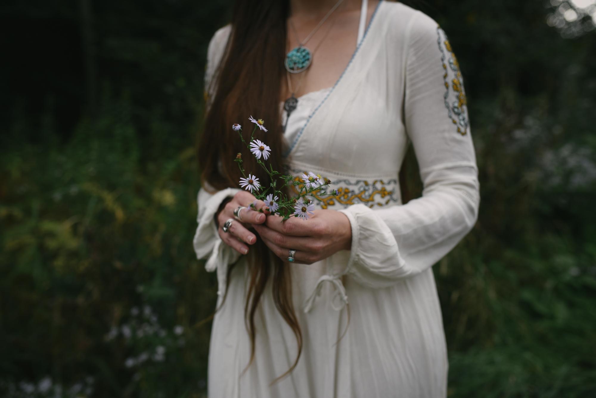 Mountain Wedding, Outdoors, Rustic, West Virginia, Maryland Wedding Photographer, DIY, Casual, Bride holding wildflowers, emroidered wedding dress, boho wedding