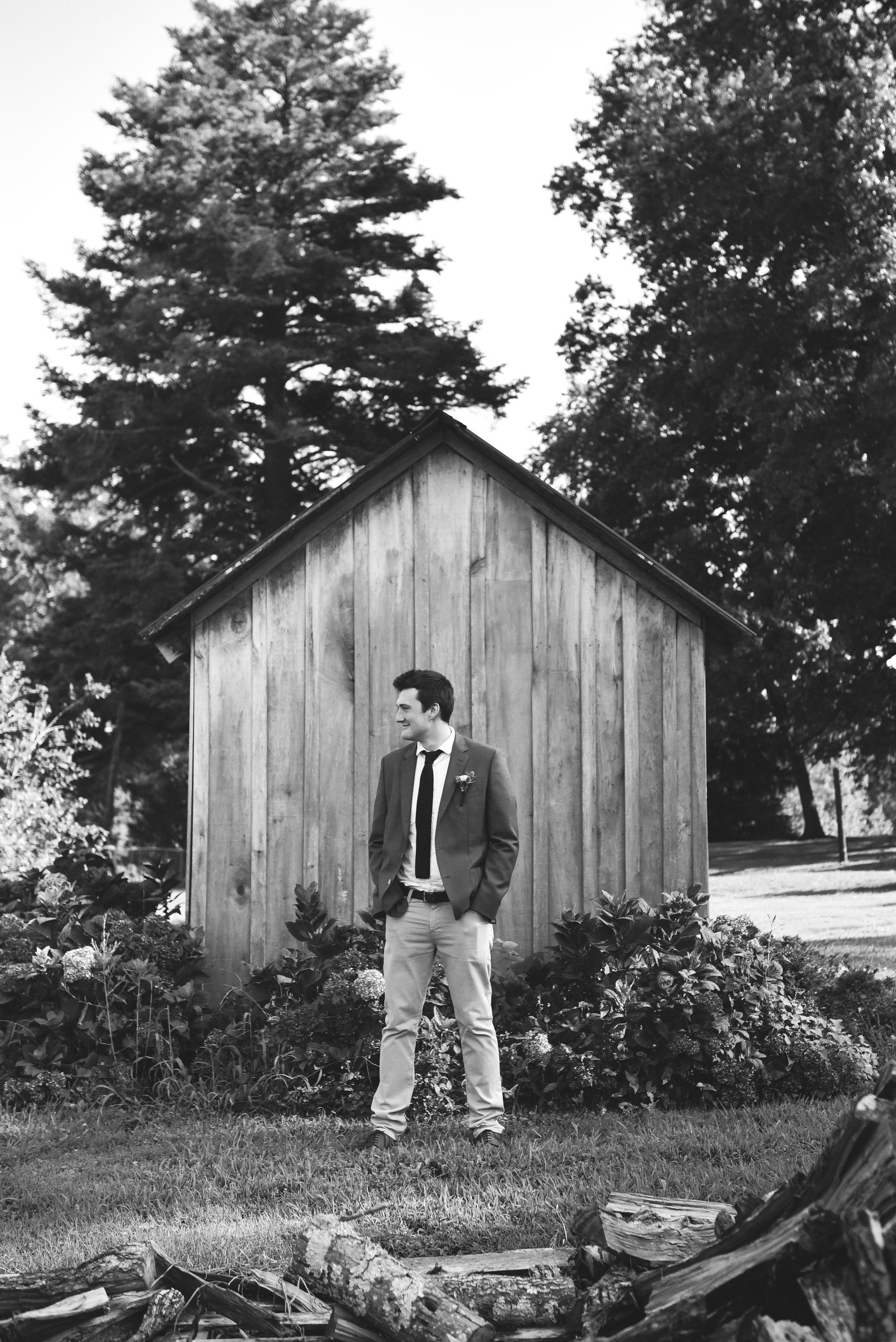 Maryland, Eastern Shore, Baltimore Wedding Photographer, Romantic, Boho, Backyard Wedding, Nature, Black and White Photo, Portrait of Groom Outside