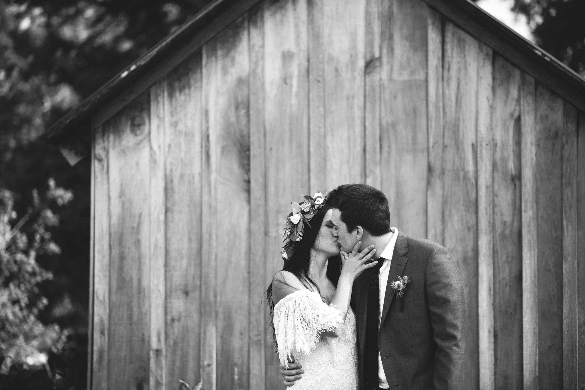 Maryland, Eastern Shore, Baltimore Wedding Photographer, Romantic, Boho, Backyard Wedding, Nature, Black and White Photo, Bride and Groom Kissing, Michael Designs Florist, Daughters of Simone Dress