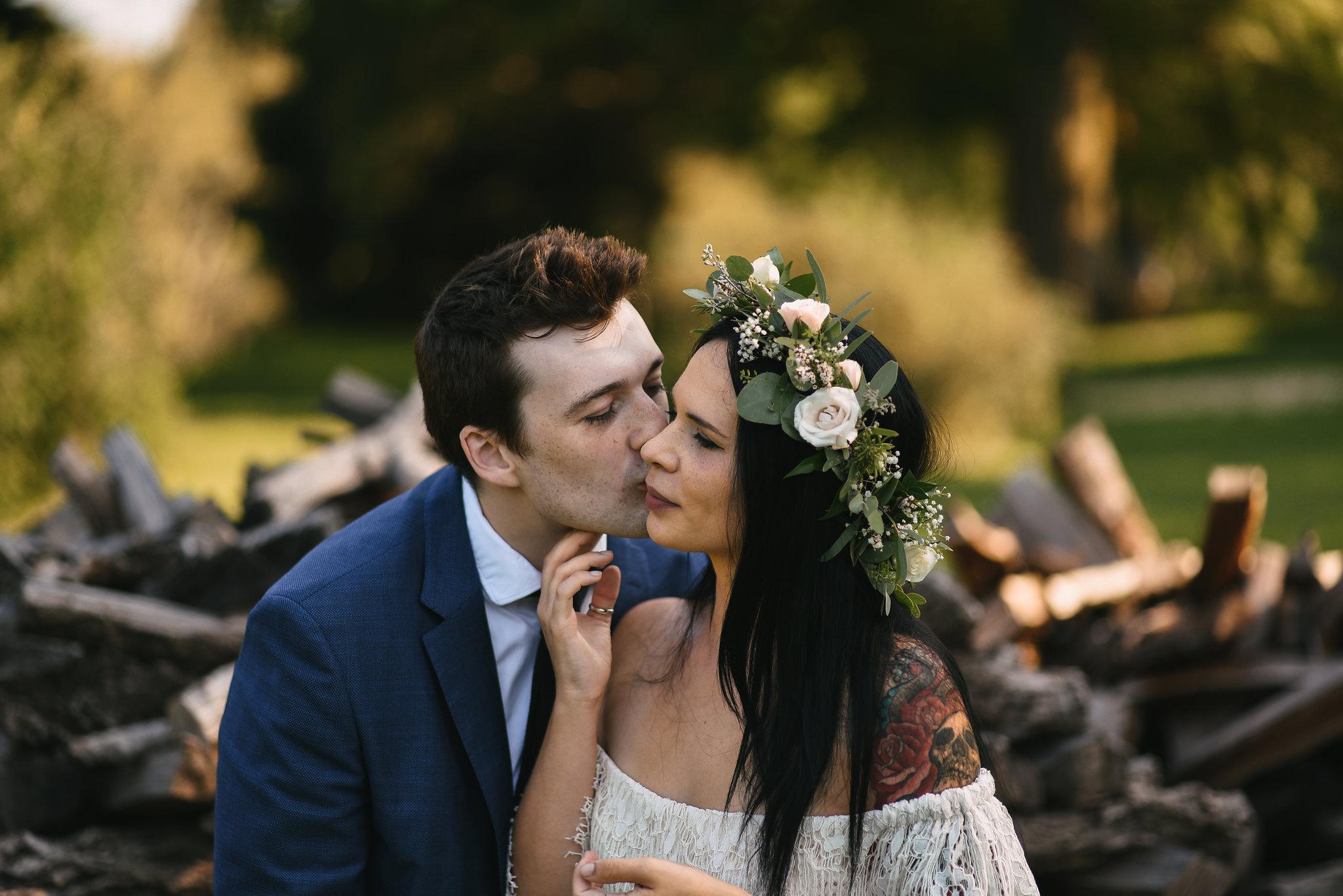 Maryland, Eastern Shore, Baltimore Wedding Photographer, Romantic, Boho, Backyard Wedding, Nature, Groom Kissing Bride on the Cheek, Michael Designs Florist, Tattooed Bride