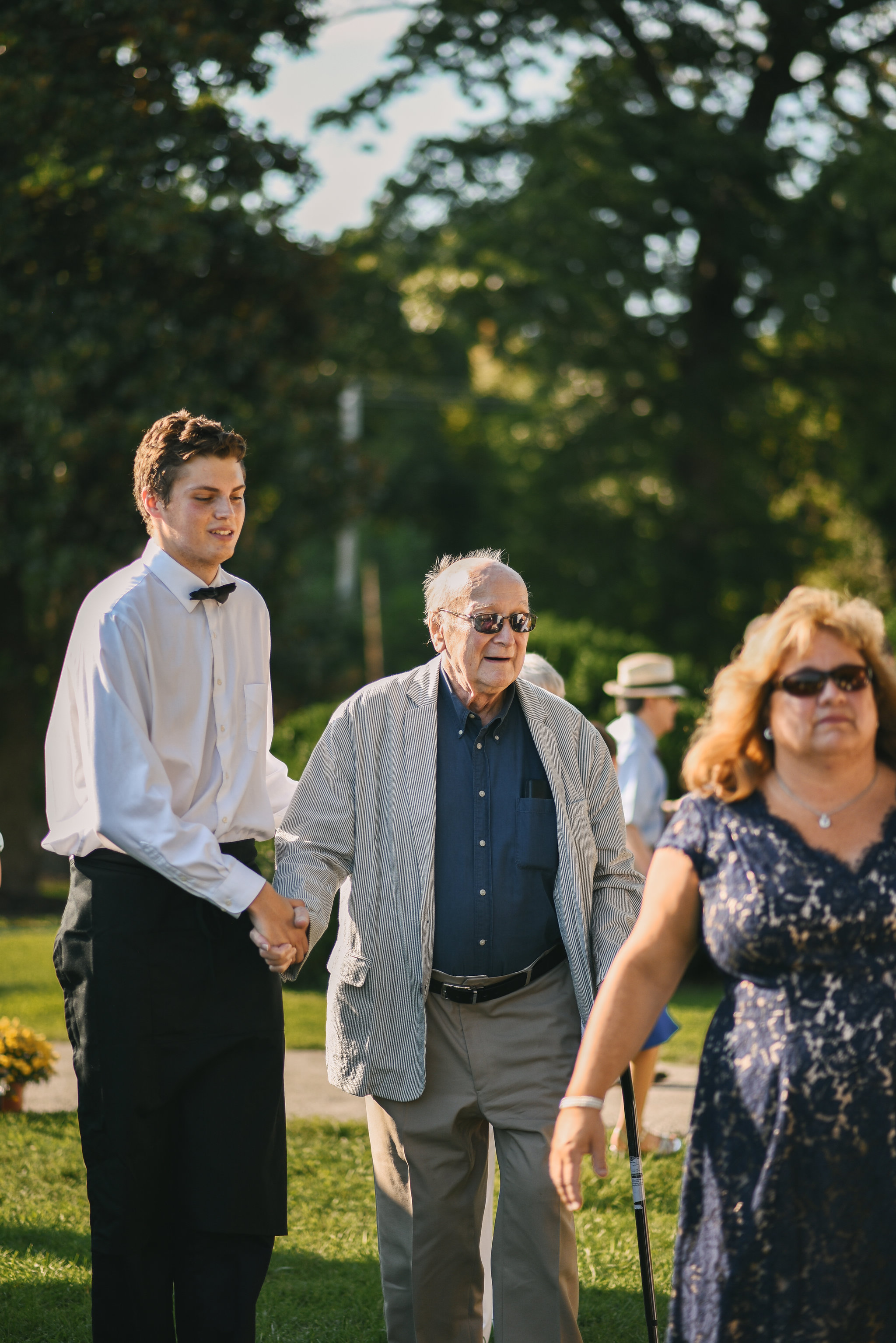 Maryland, Eastern Shore, Baltimore Wedding Photographer, Romantic, Boho, Backyard Wedding, Nature, Family Members Making Their Way to Reception, Guests Walking Outside