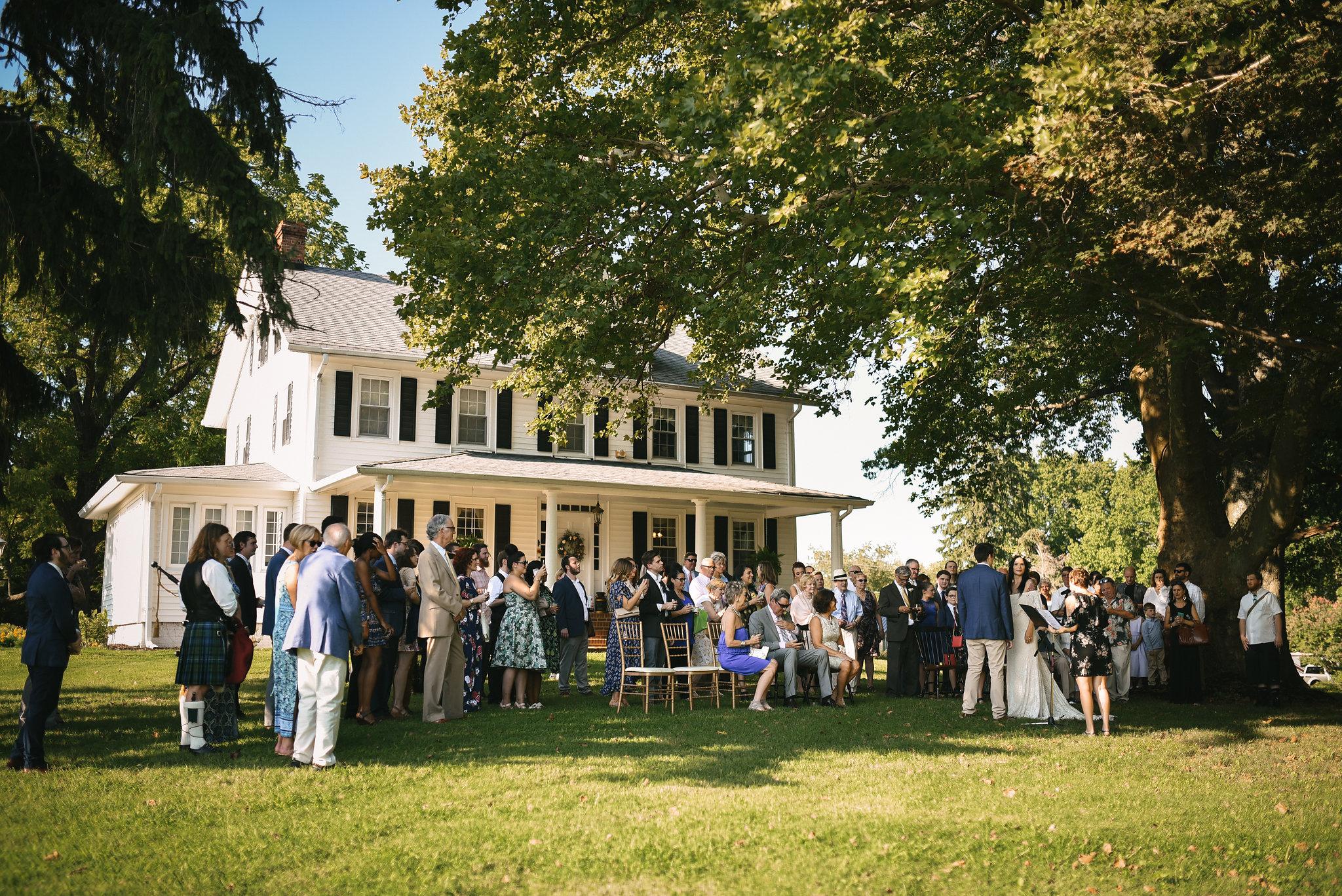 Maryland, Eastern Shore, Baltimore Wedding Photographer, Romantic, Boho, Backyard Wedding, Nature, Guests Gathered in Backyard for Ceremony
