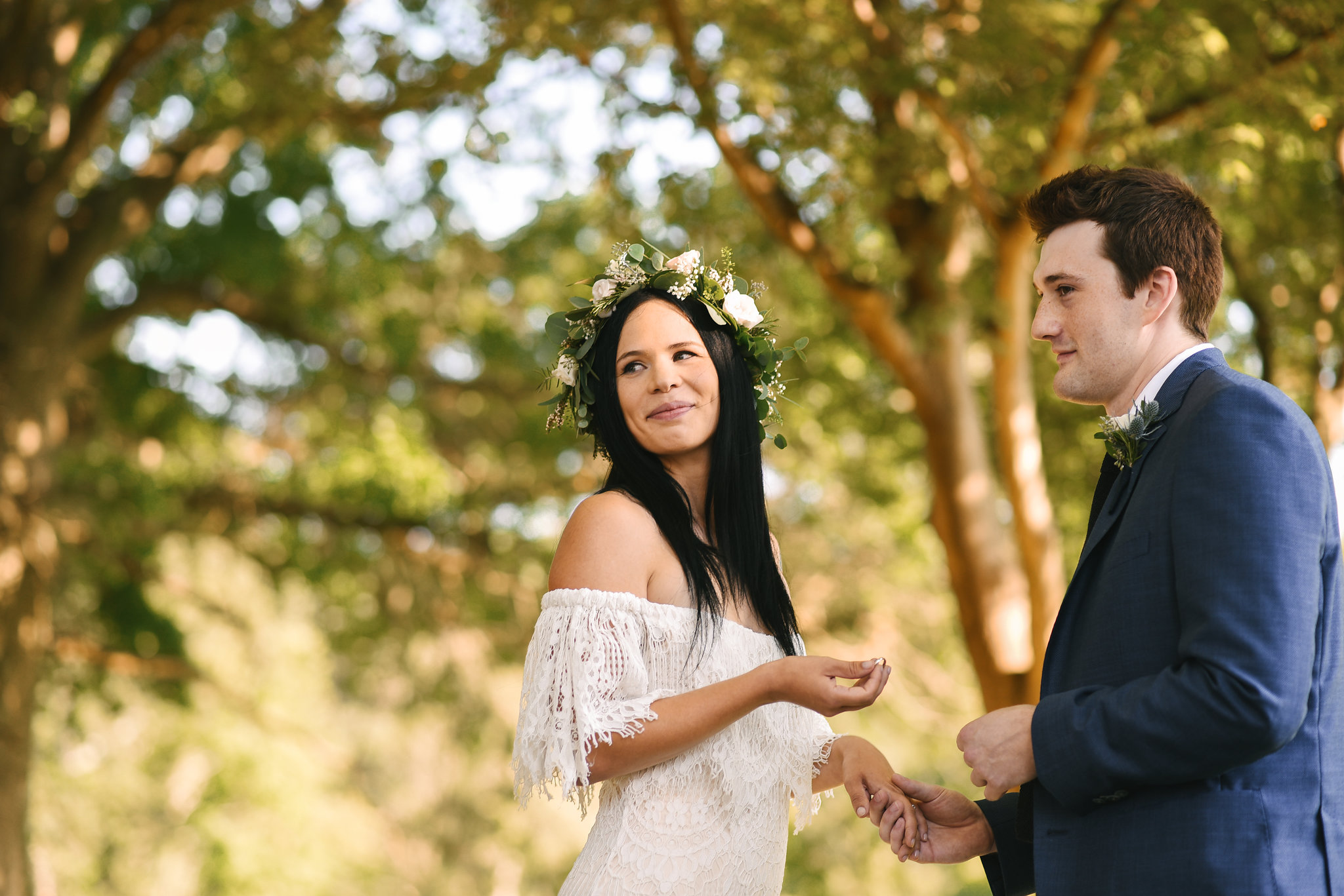 Maryland, Eastern Shore, Baltimore Wedding Photographer, Romantic, Boho, Backyard Wedding, Nature, Bride and Groom Smiling at Guests While Exchanging Rings