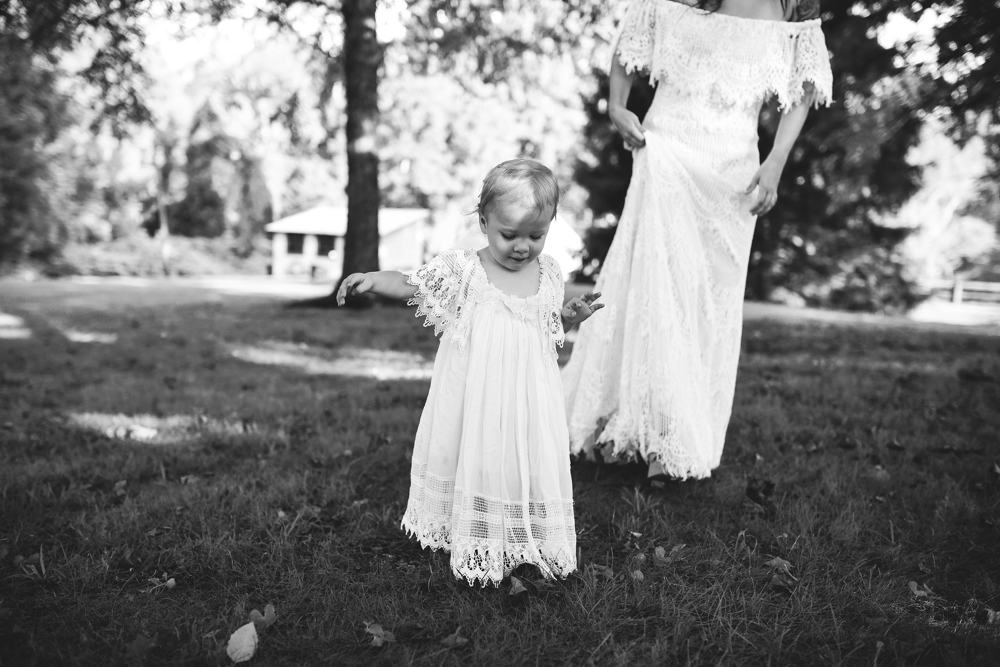 Maryland, Eastern Shore, Baltimore Wedding Photographer, Romantic, Boho, Backyard Wedding, Nature, Bride Walking with Flower Girl in Lace Dress, Black and White Photo