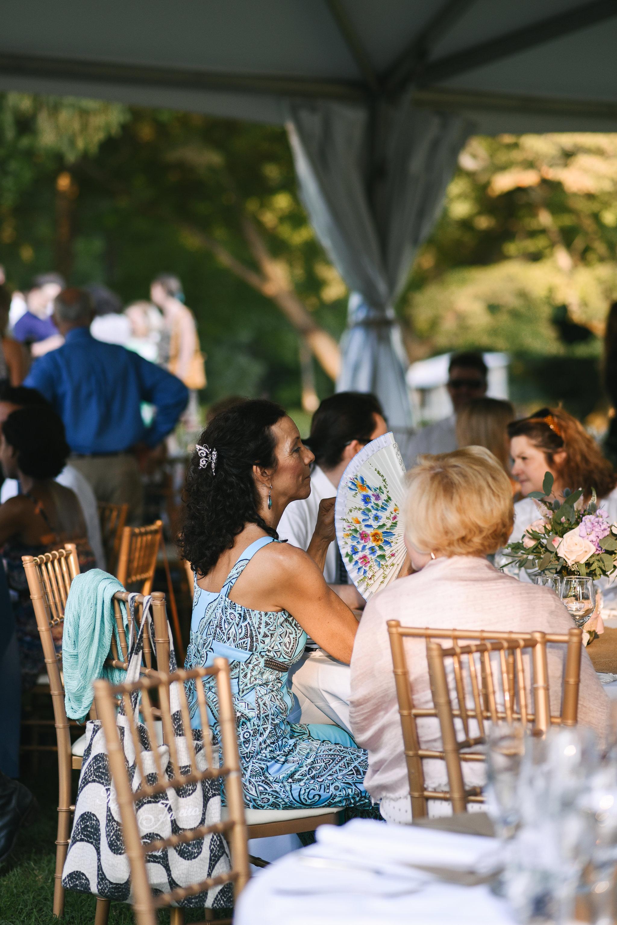 Maryland, Eastern Shore, Baltimore Wedding Photographer, Romantic, Boho, Backyard Wedding, Nature, Wedding Guest Fanning Herself at Reception