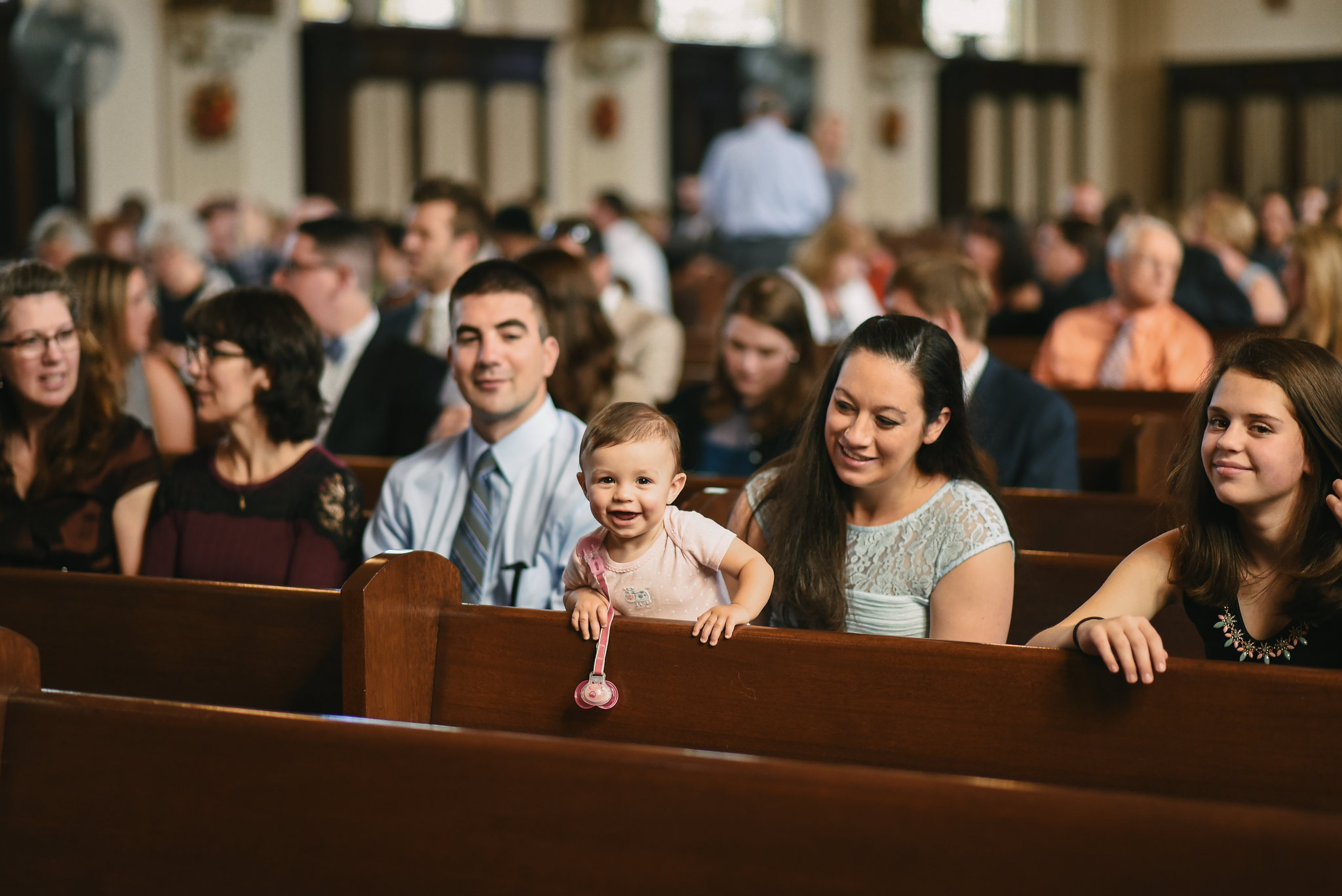 Baltimore, Canton, Church Wedding, Modern, Outdoors, Maryland Wedding Photographer, Romantic, Classic, St. Casimir Church, Guests being seated for ceremony, Wedding Guest with Baby