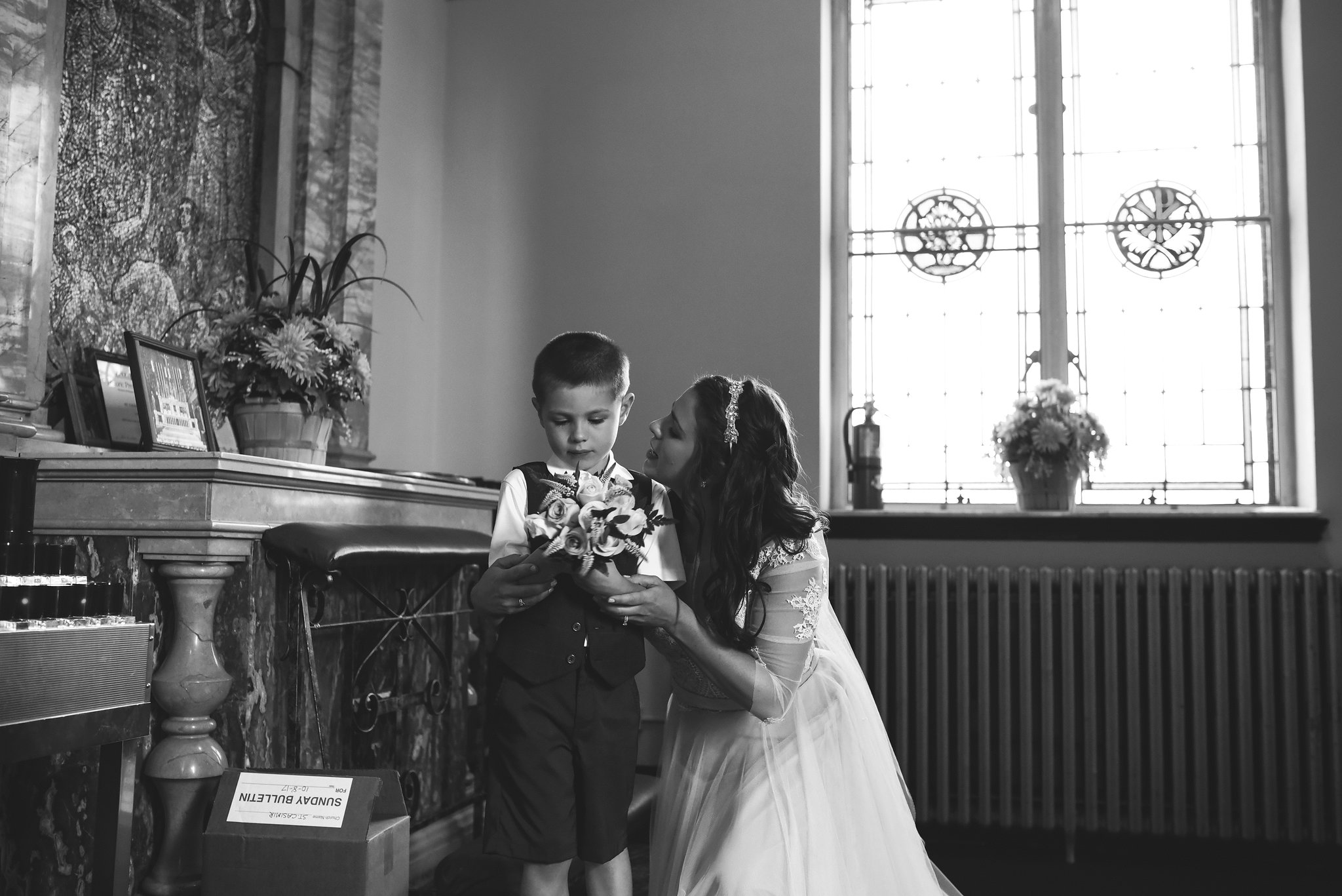 Baltimore, Canton, Church Wedding, Modern, Outdoors, Maryland Wedding Photographer, Romantic, Classic, St. Casimir Church, Black and White Photo, Bride talking to little boy with bouquet