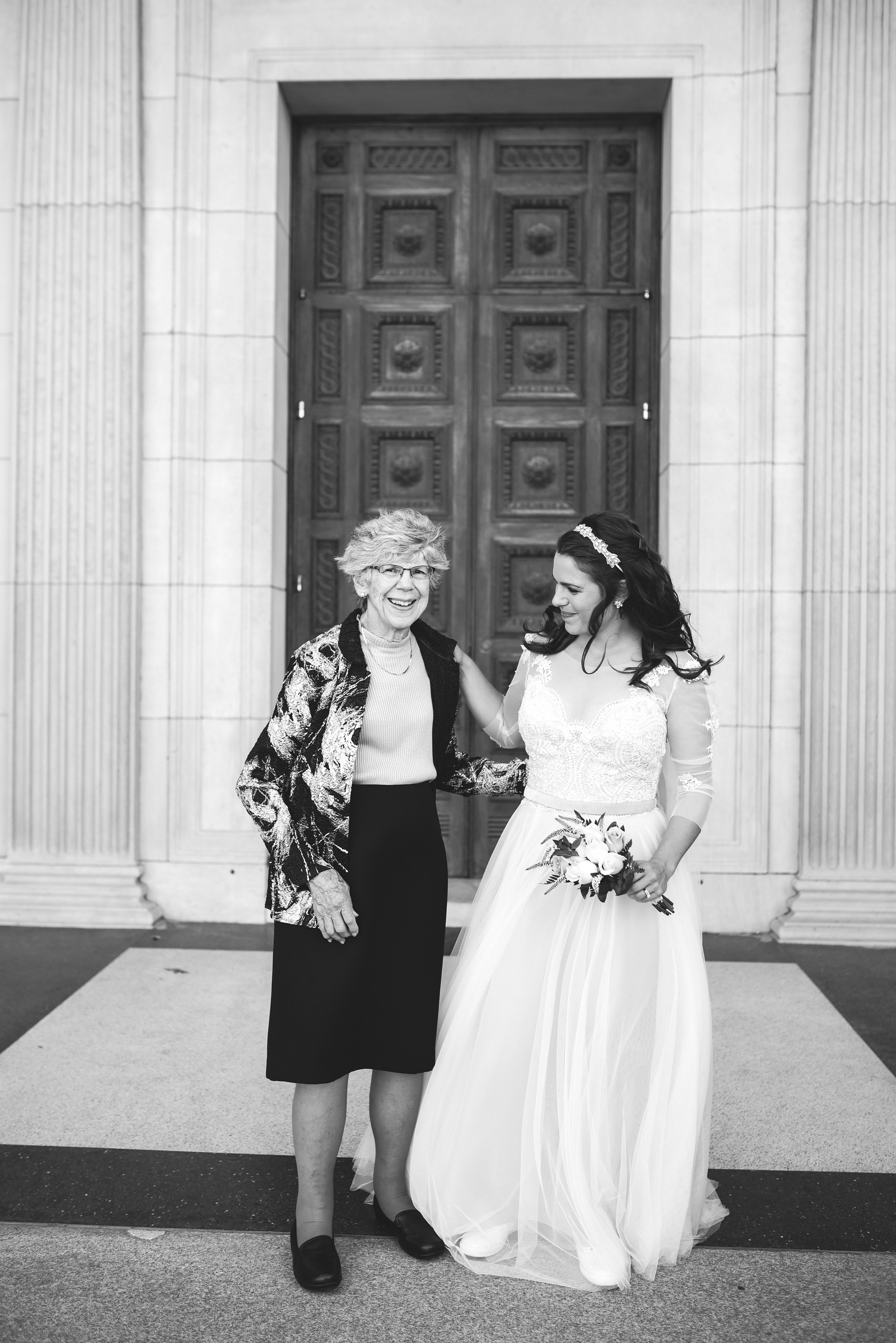 Baltimore, Canton, Church Wedding, Modern, Outdoors, Maryland Wedding Photographer, Romantic, Classic, St. Casimir Church, Black and White Photo, Portrait of bride with family outside of church, lace wedding dress