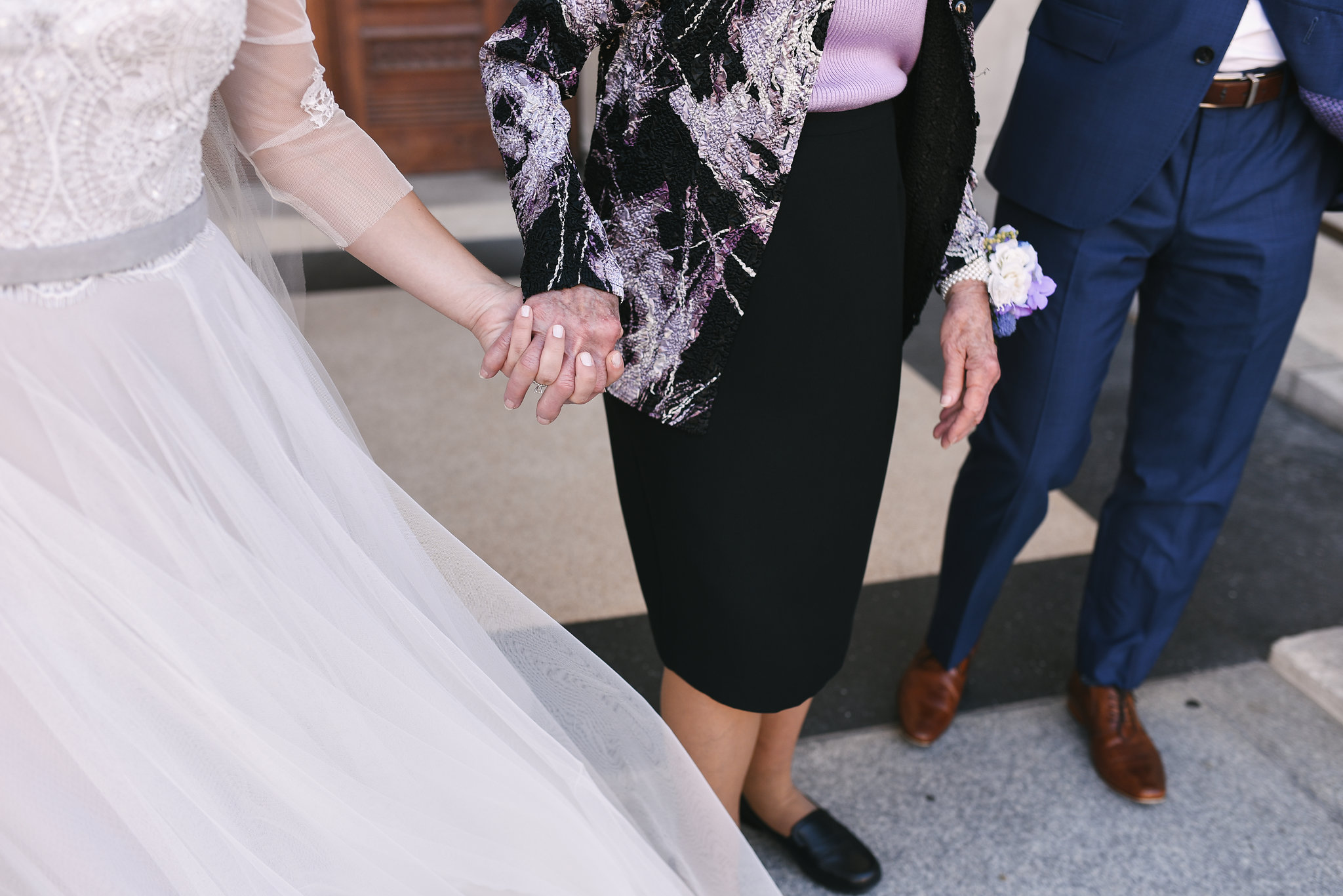 Baltimore, Canton, Church Wedding, Modern, Outdoors, Maryland Wedding Photographer, Romantic, Classic, St. Casimir Church, Bride holding hands with family, lace and tulle wedding dress