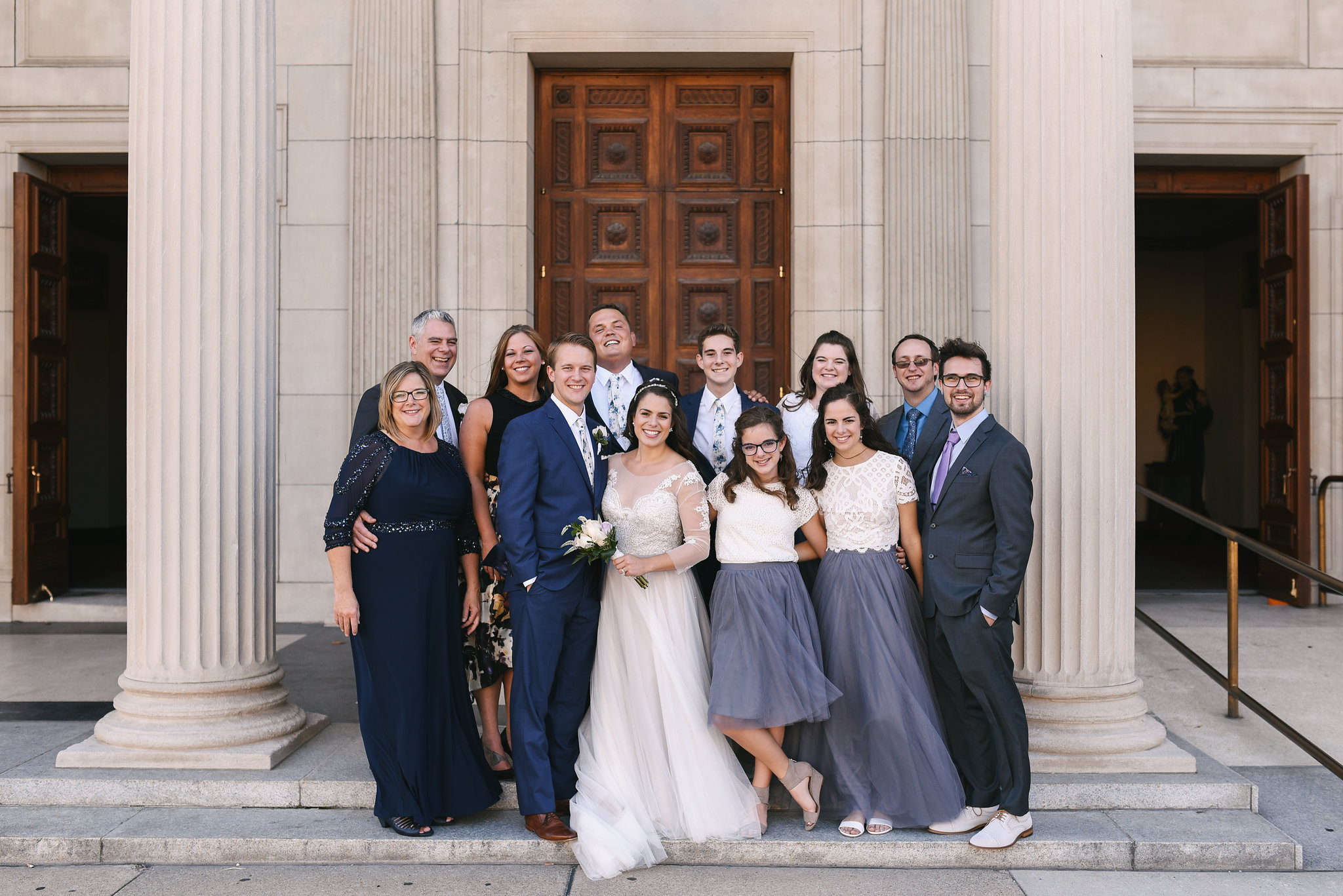 Baltimore, Canton, Church Wedding, Modern, Outdoors, Maryland Wedding Photographer, Romantic, Classic, St. Casimir Church, Portrait of bride and groom with family, white and purple roses