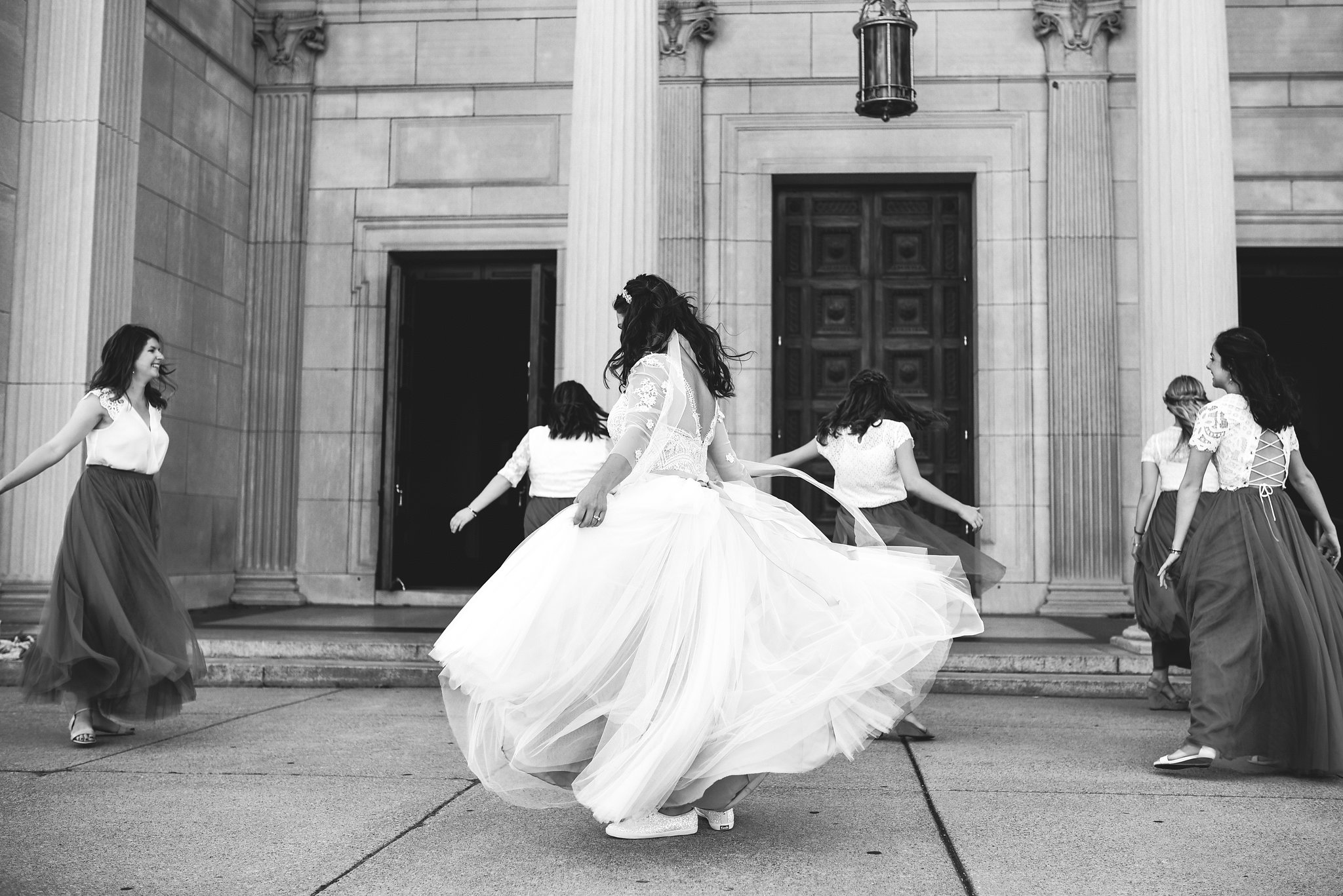 Baltimore, Canton, Church Wedding, Modern, Outdoors, Maryland Wedding Photographer, Romantic, Classic, Black and White Photo, Glittery Sneakers, Lace wedding dress, Bride and bridesmaids dancing on sidewalk