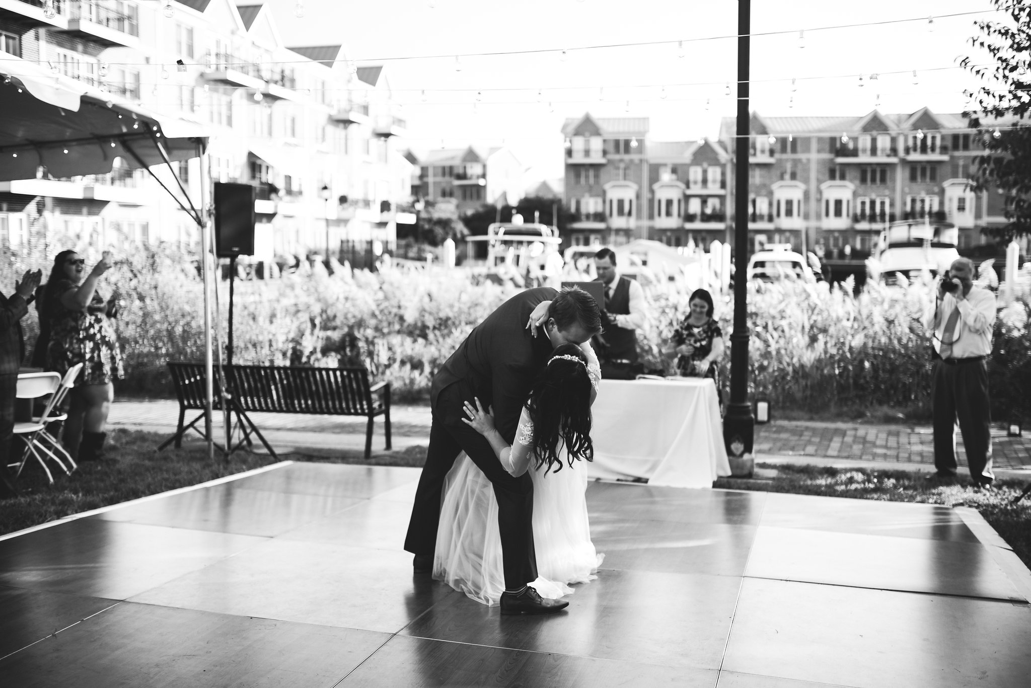 Baltimore, Canton, Church Wedding, Modern, Outdoors, Maryland Wedding Photographer, Romantic, Classic, St. Casimir Church, Black and white photo, Groom dipping Bride on dancefloor, Bride and Groom kiss at reception