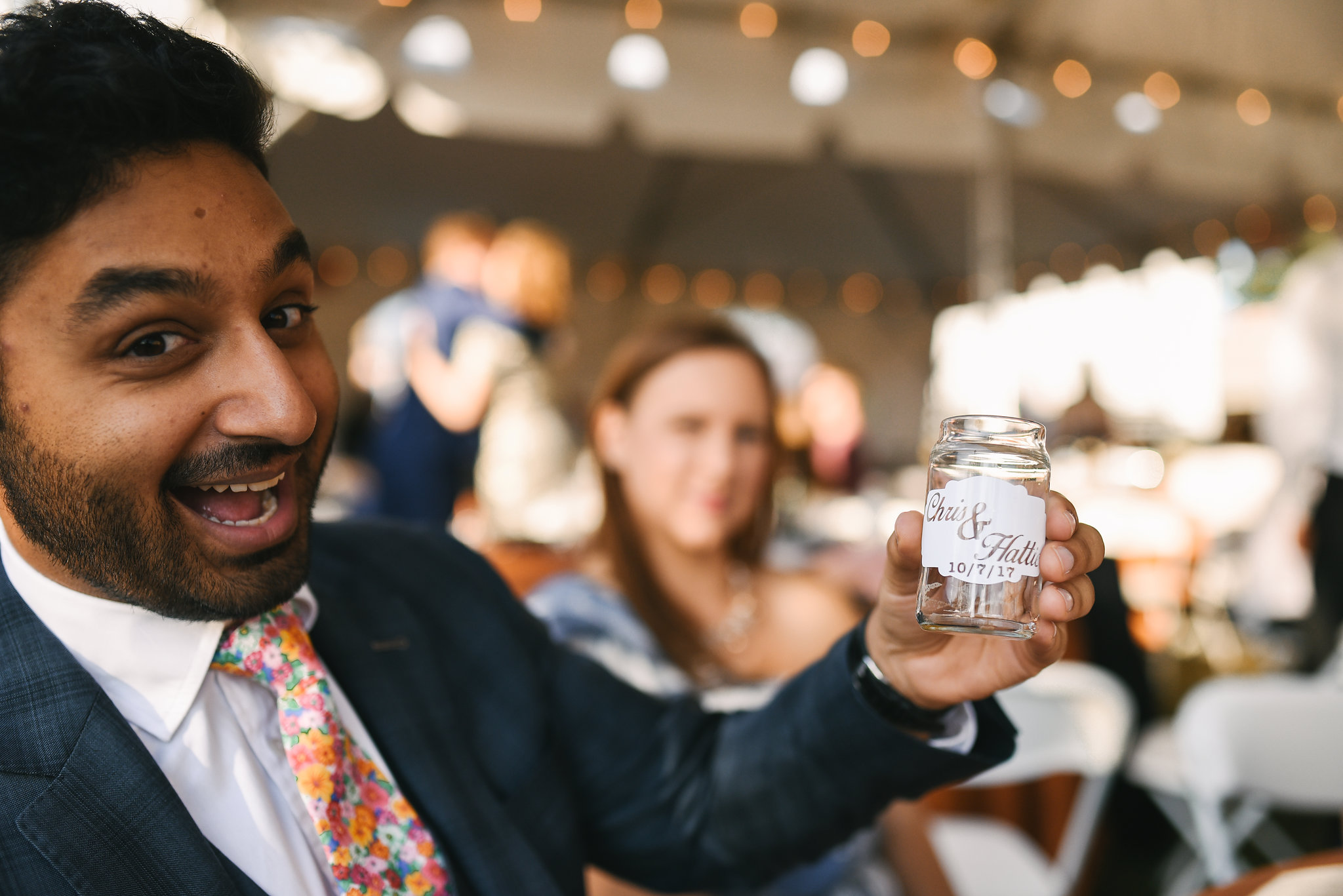 Baltimore, Canton, Modern, Outdoor Reception, Maryland Wedding Photographer, Romantic, Classic, Boston Street Pier Park, Wedding guest smiling and holding custom beer glass