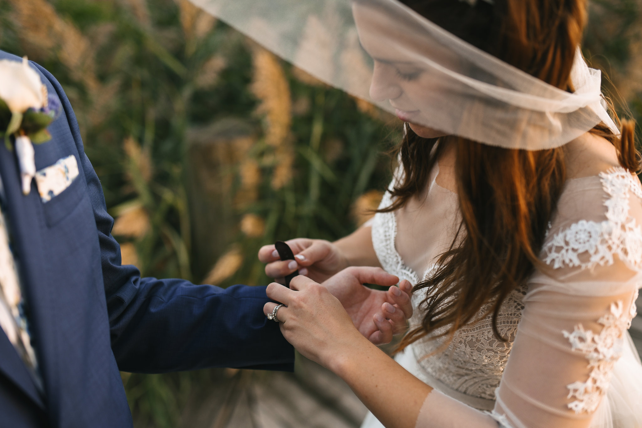 Baltimore, Canton, Church Wedding, Modern, Outdoors, Maryland Wedding Photographer, Romantic, Classic, Lace Wedding Dress, Bride helping groom put on watch
