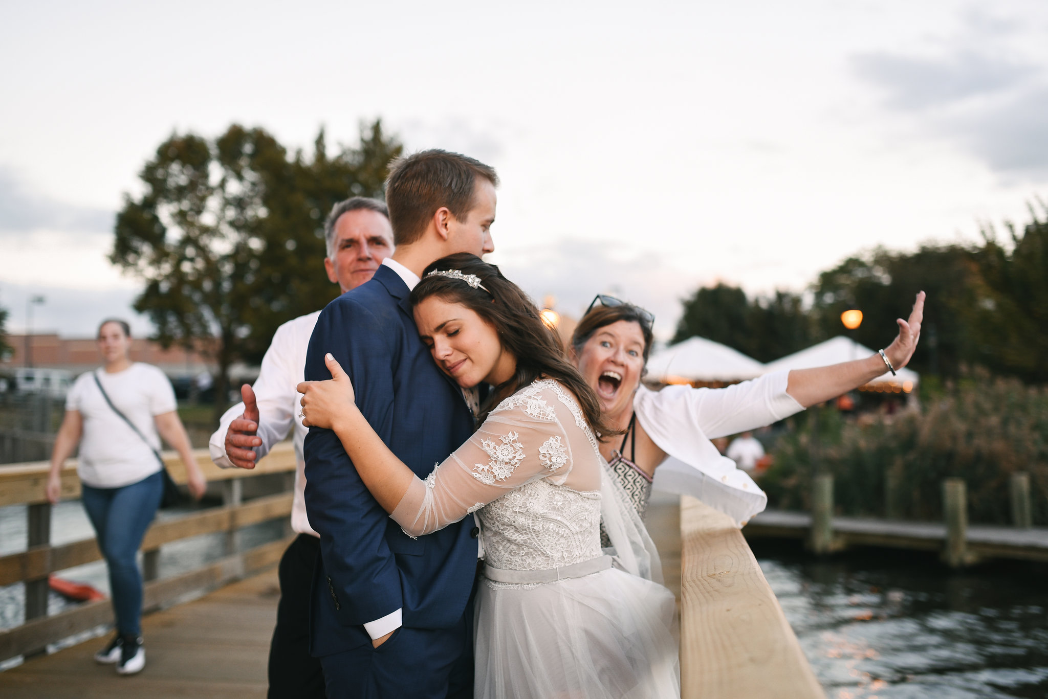 Baltimore, Canton, Modern, Outdoor Reception, Maryland Wedding Photographer, Romantic, Classic, Boston Street Pier Park, Portrait of bride and groom crashed by friends, Fun photo