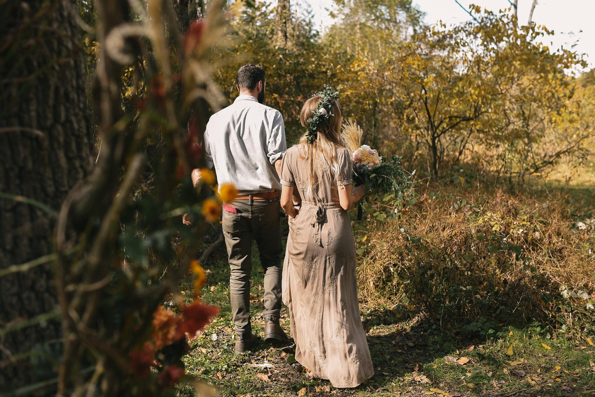 Bride and Groom walking down backyard path