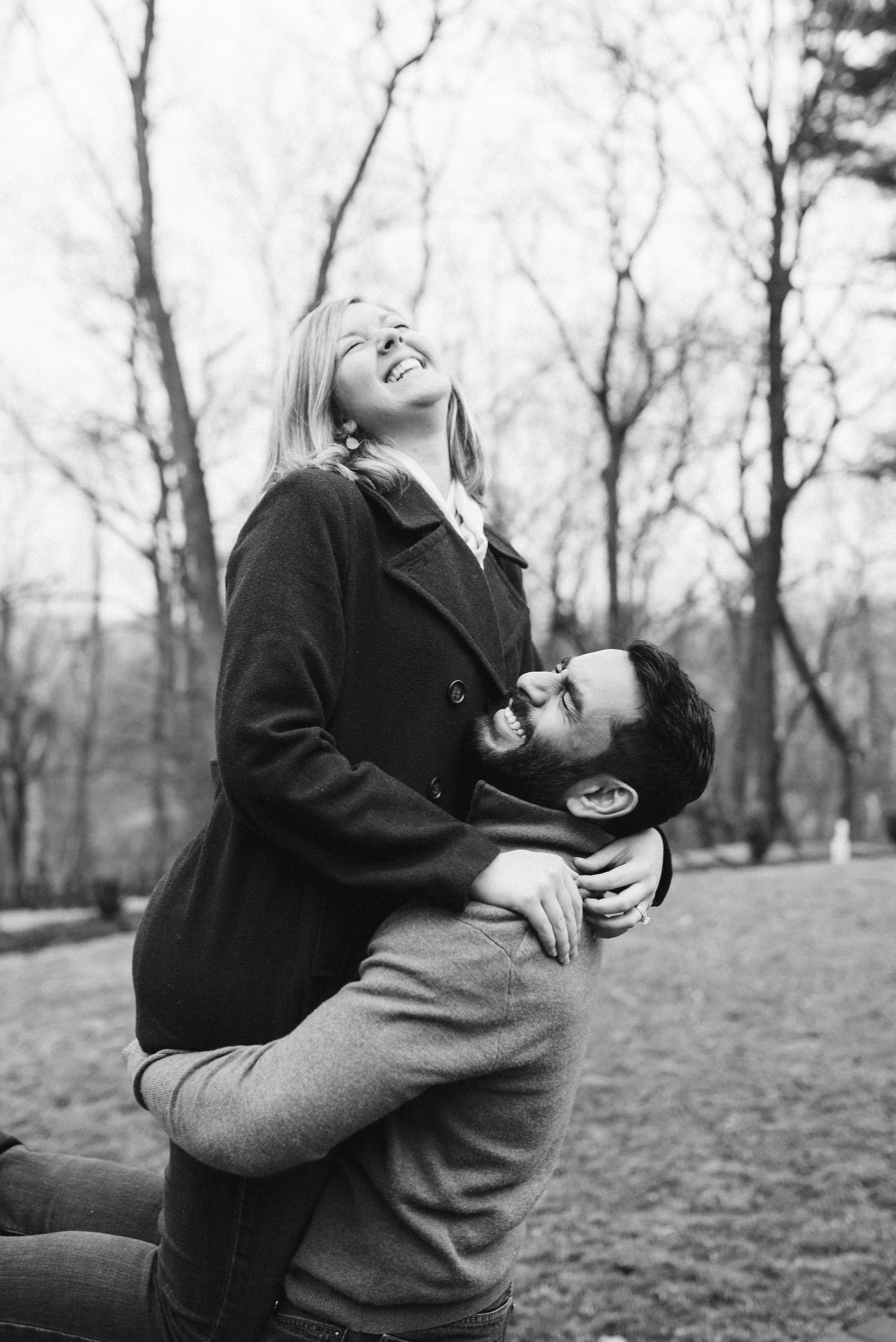 Engagement Photos, Rainy, Ellicott City, Maryland Wedding Photographer, Winter, Overhills Mansion, Classic, Traditional, Outdoor, Groom Lifting Bride, Black and White Photo