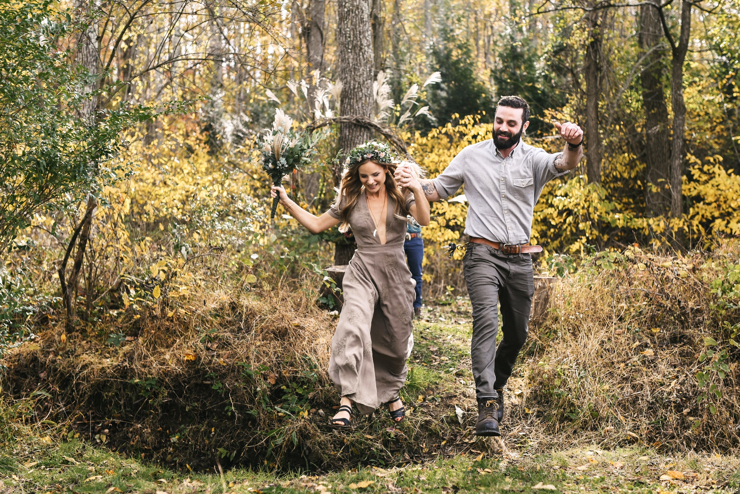 Baltimore, Maryland Wedding Photographer, Backyard Wedding, DIY, Rustic, Casual, Fall Wedding, Woodland, Bride and Groom Jumping Through Field, Just Married, Brightside Boutique Dress