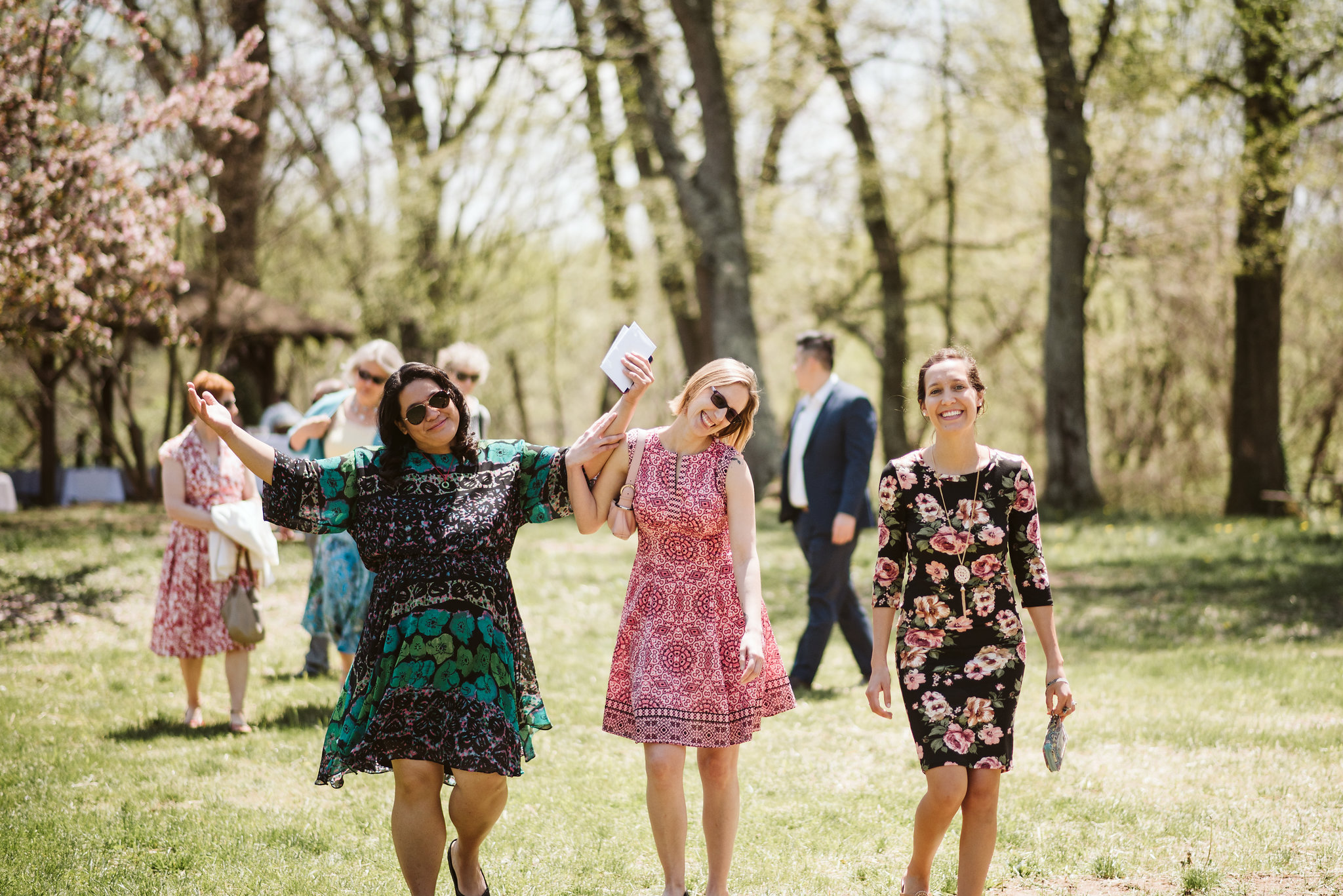 Spring Outdoor Wedding, Park, Baltimore Wedding Photographer, DIY, Classic, Upcycled, Garden Party, Romantic, Guests Smiling and Walking to Ceremony