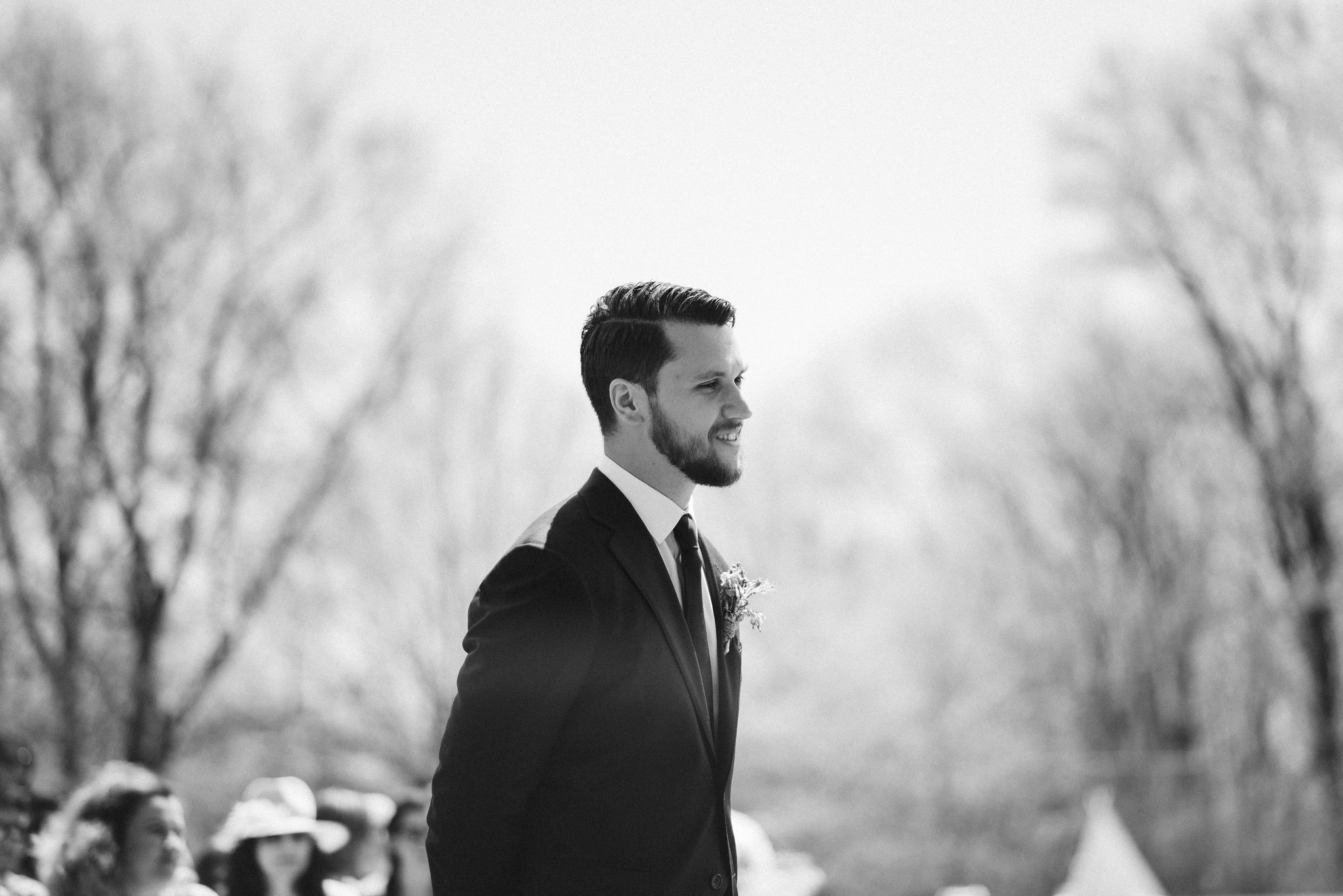 Spring Outdoor Wedding, Park, Baltimore Wedding Photographer, DIY, Classic, Upcycled, Garden Party, Romantic, Groom Waiting at the End of the Aisle, Black and White Photo, SuitSupply