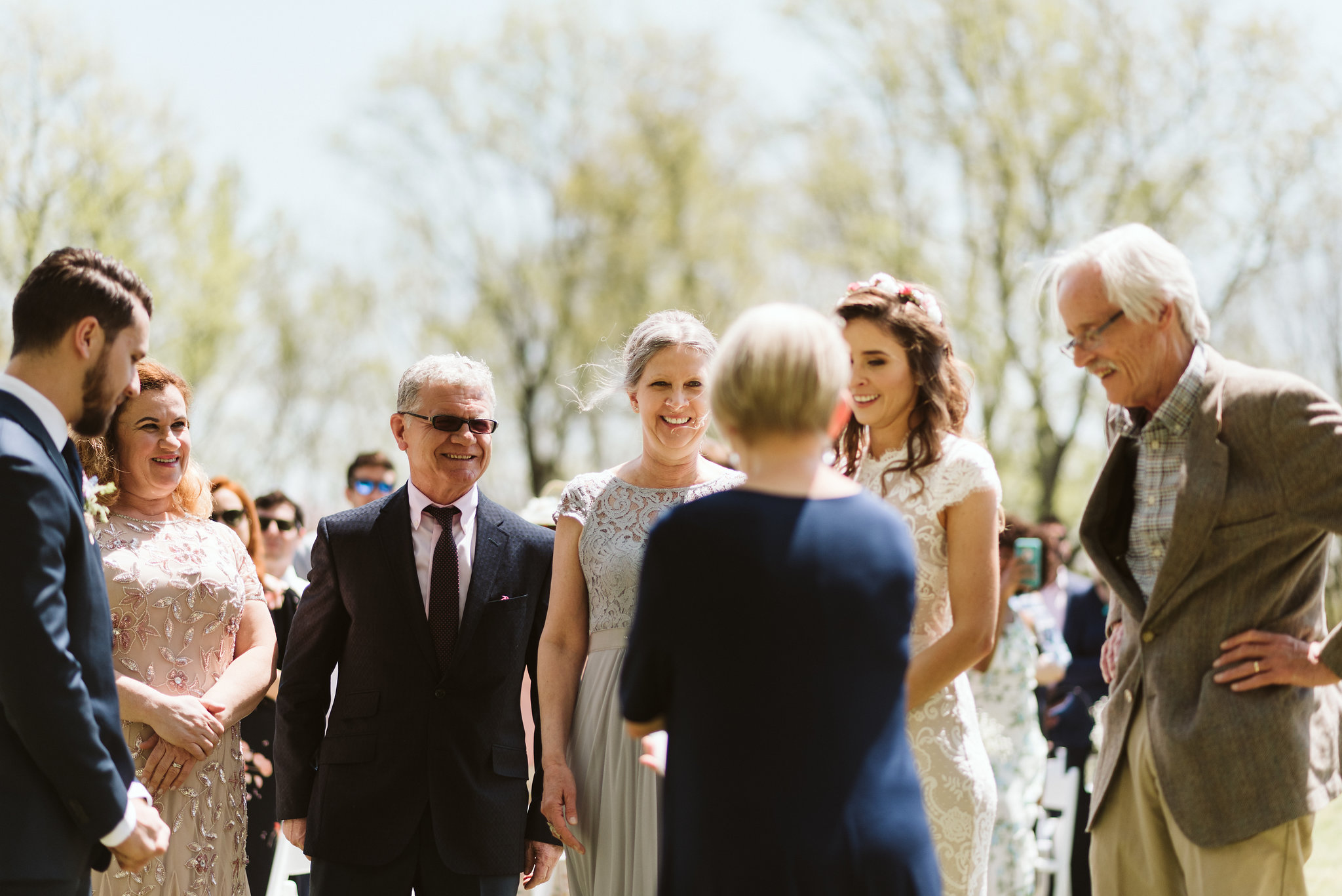 Spring Outdoor Wedding, Park, Baltimore Wedding Photographer, DIY, Classic, Upcycled, Garden Party, Romantic, Bride Reaching the End of the Aisle, Parents Smiling at Eachother, Suit Supply,
