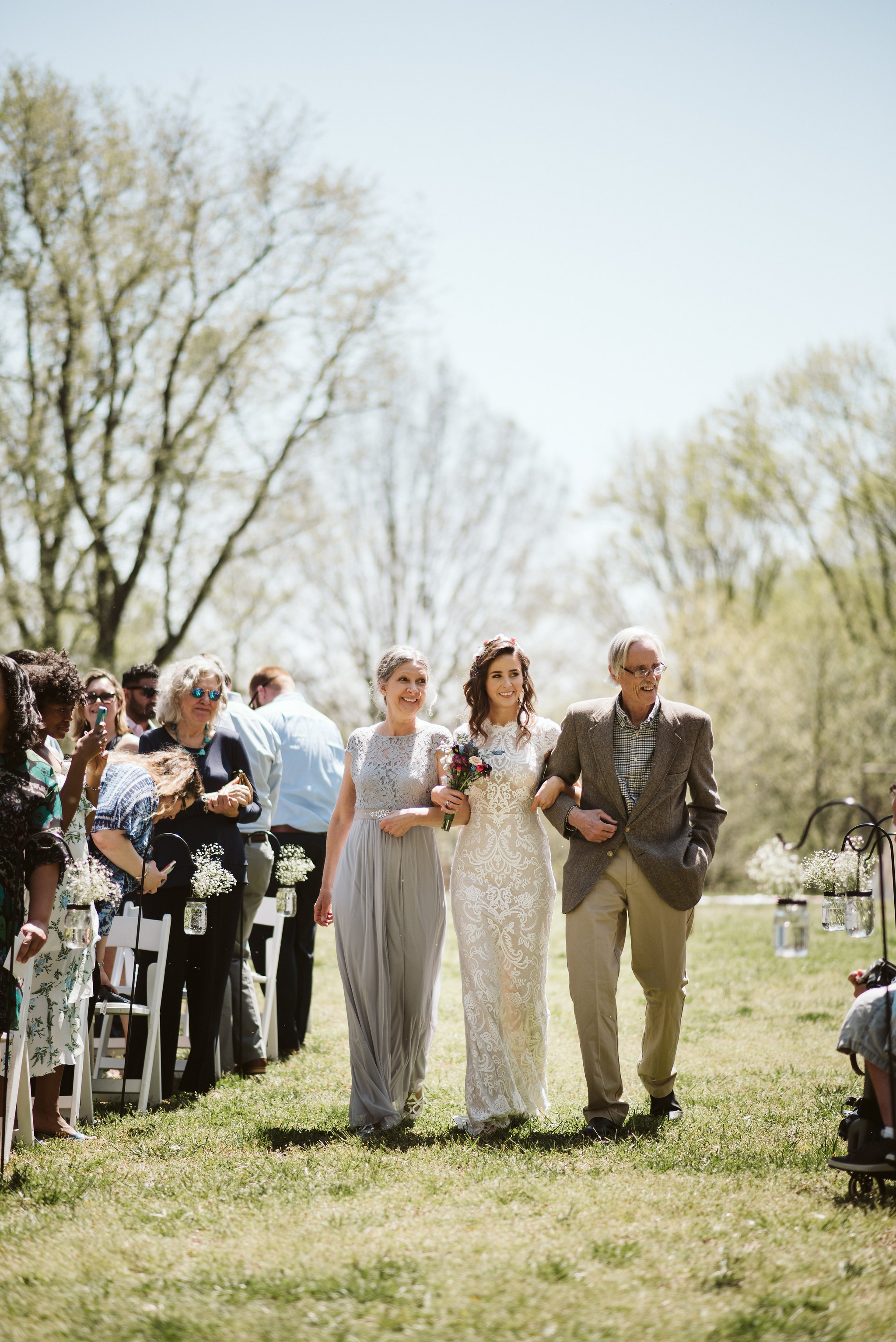 Spring Outdoor Wedding, Park, Baltimore Wedding Photographer, DIY, Classic, Upcycled, Garden Party, Romantic, Bride Walking Down the Aisle with Parents, BHLDN Wedding Dress, Flower Crown