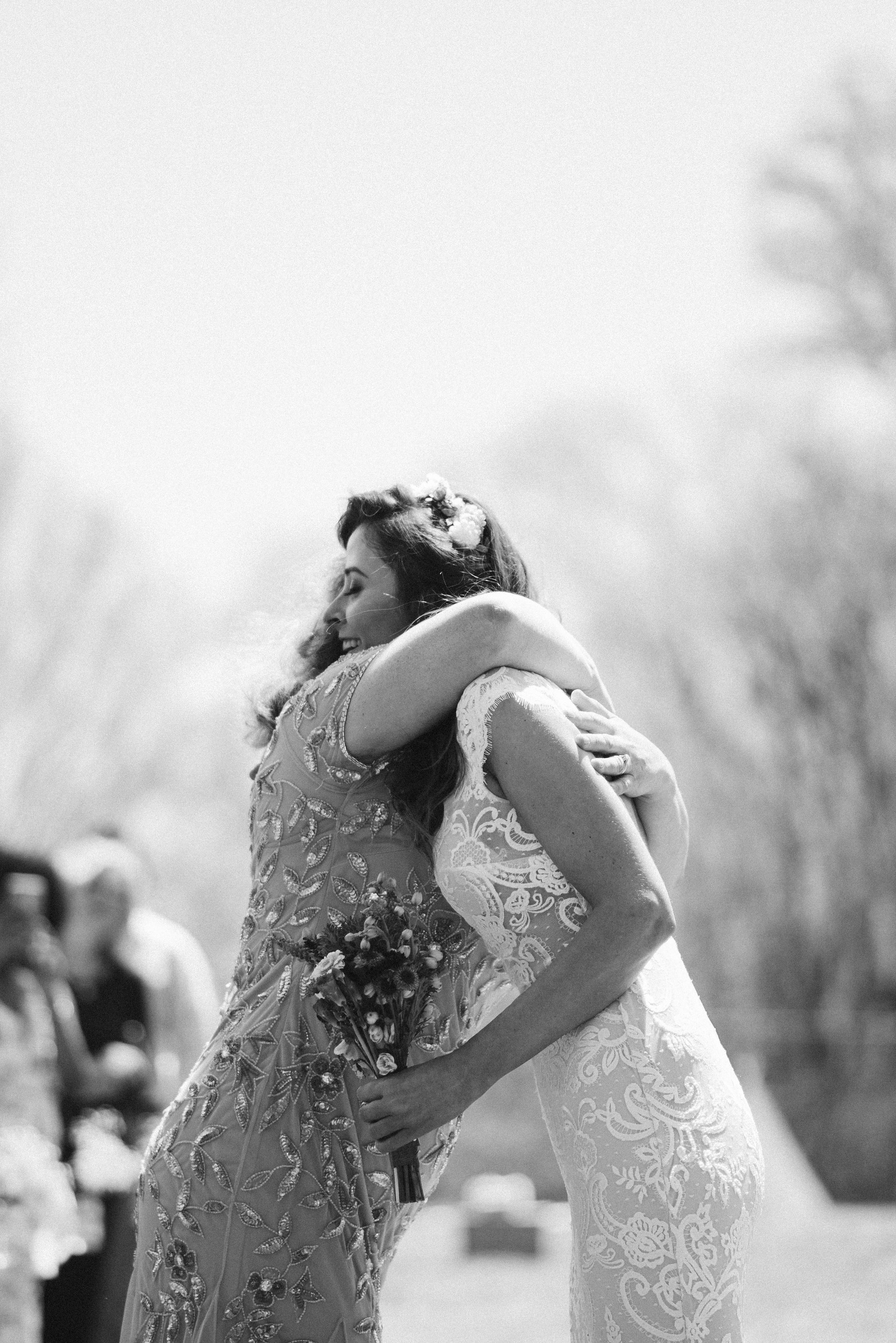 Spring Outdoor Wedding, Park, Baltimore Wedding Photographer, DIY, Classic, Upcycled, Garden Party, Romantic, Bride Hugging Mother in Law, BHLDN Wedding Dress, Flower Crown, Black and White Photo