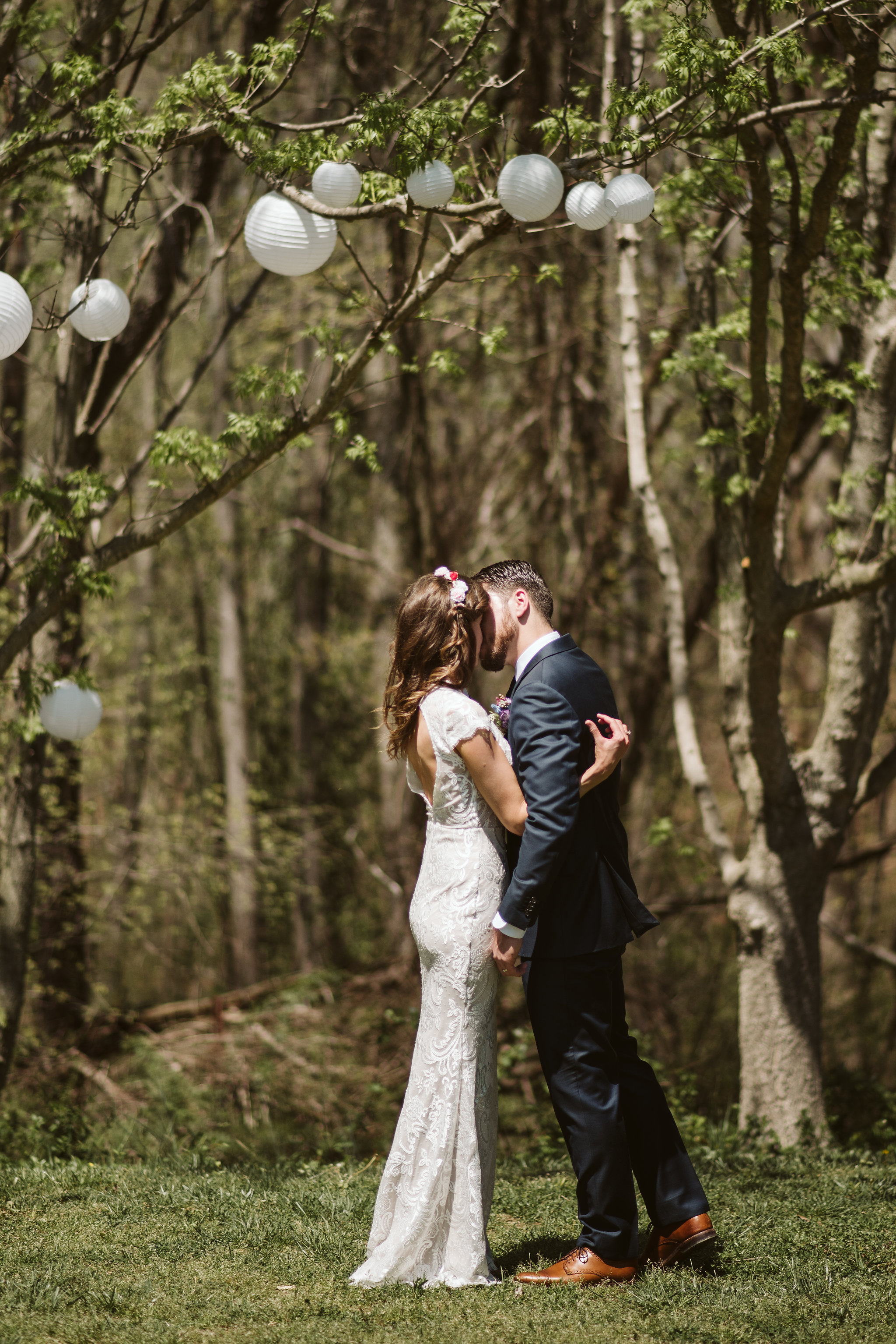 Spring Outdoor Wedding, Park, Baltimore Wedding Photographer, DIY, Classic, Upcycled, Garden Party, Romantic,  Bride and Groom Sharing Their First Kiss, Flower Crown
