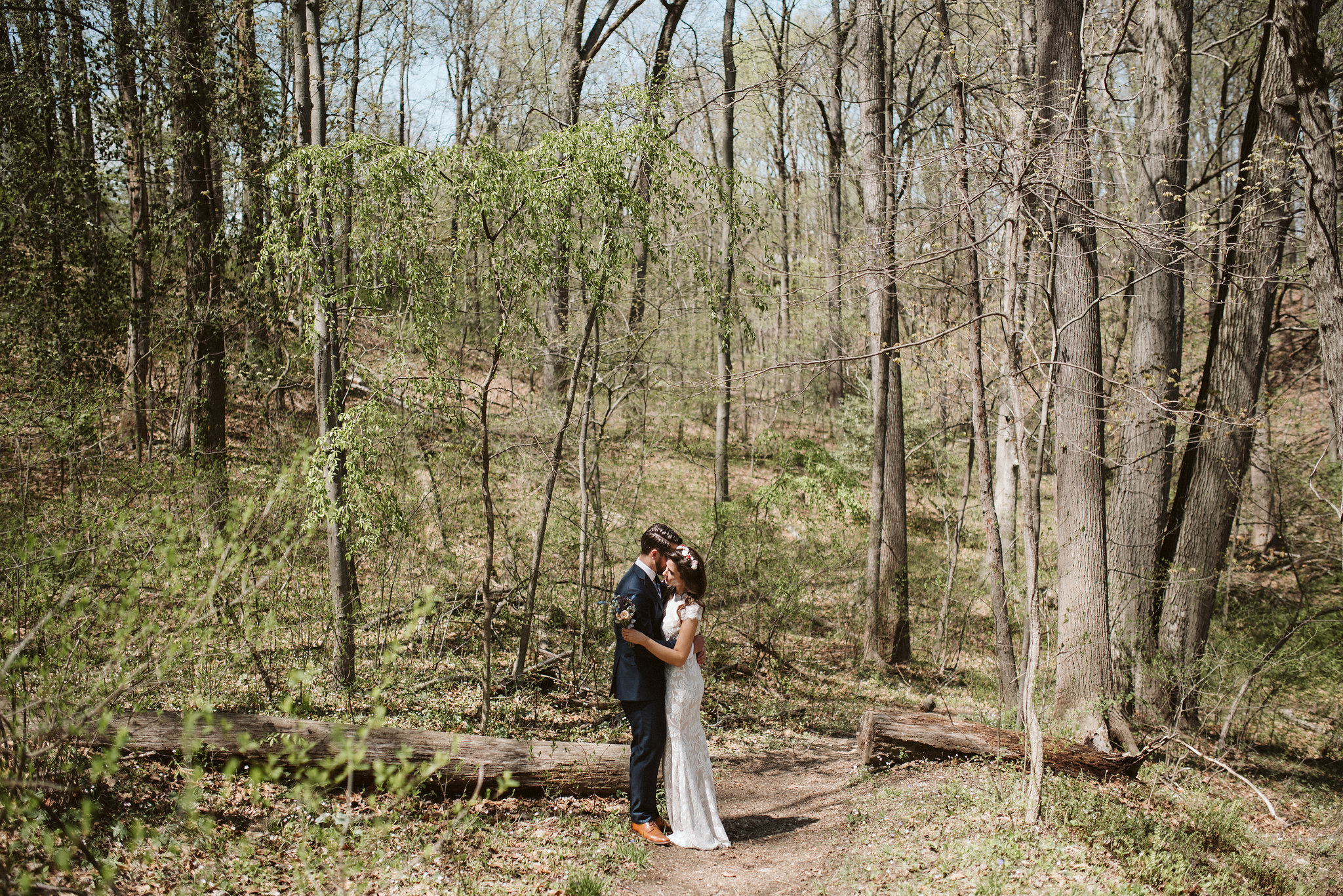 Spring Outdoor Wedding, Park, Baltimore Wedding Photographer, DIY, Classic, Upcycled, Garden Party, Romantic, Bride and Groom Holding Each Other in the Forest, Candid Photo