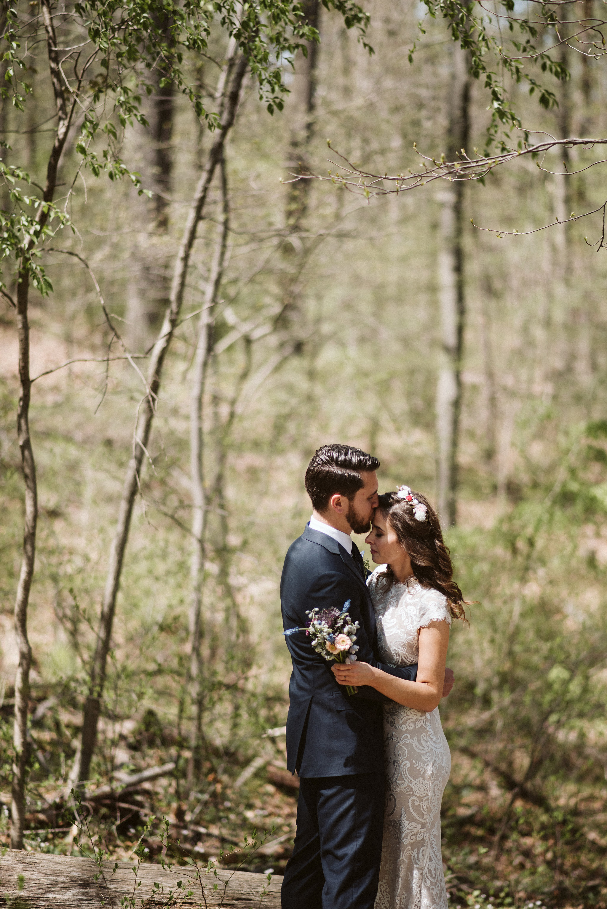 Spring Outdoor Wedding, Park, Baltimore Wedding Photographer, DIY, Classic, Upcycled, Garden Party, Romantic, Groom Kissing Bride on the Forehead, Sweet Candid Photo, Flower Crown