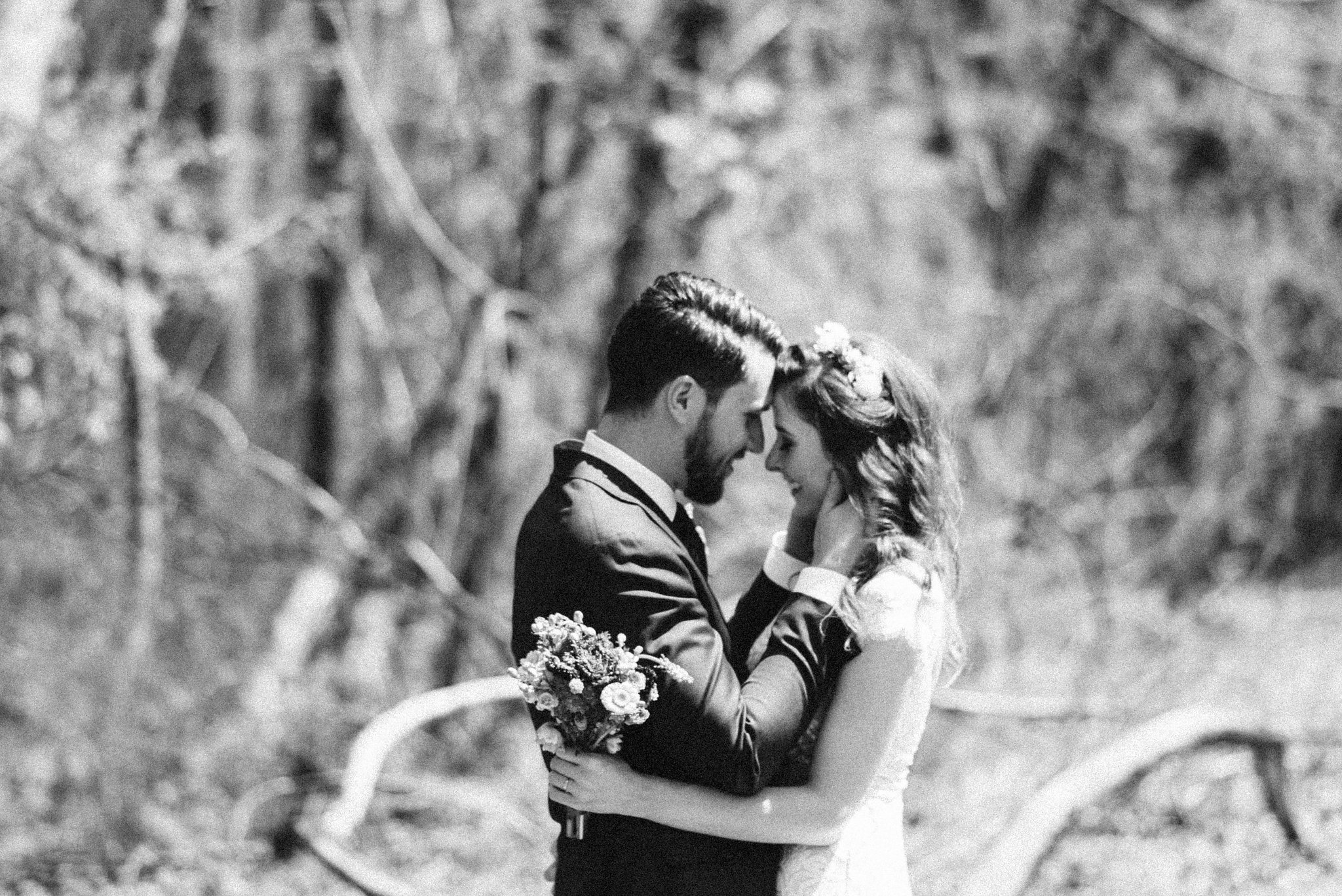 Spring Outdoor Wedding, Park, Baltimore Wedding Photographer, DIY, Classic, Upcycled, Garden Party, Romantic, Bride and Groom Holding Each Other, Black and White Photo, Soft Focus
