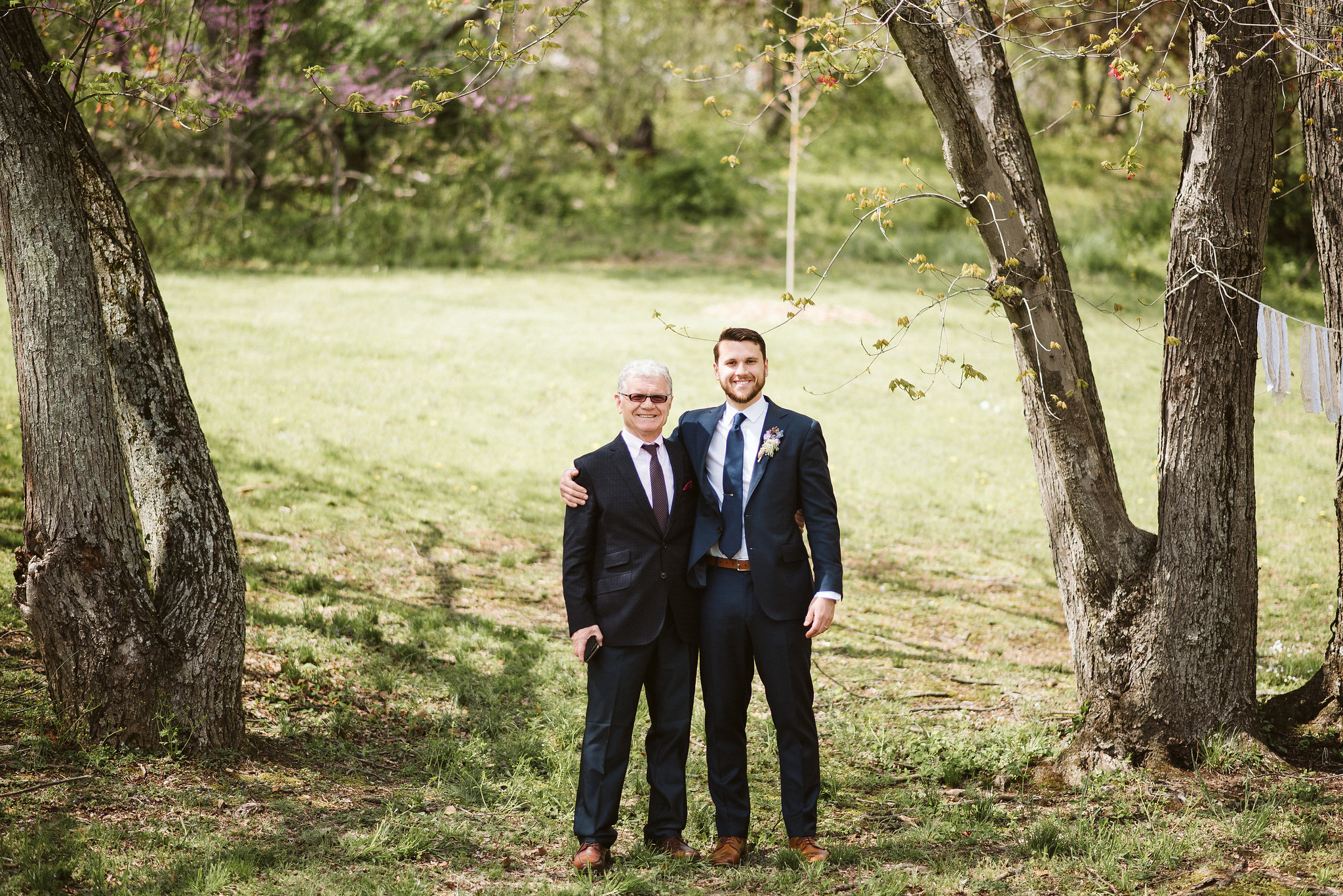 Spring Outdoor Wedding, Park, Baltimore Wedding Photographer, DIY, Classic, Upcycled, Garden Party, Romantic, Portrait of Groom with Father of the Groom, Family Portrait, Suit Supply, Wildflowers