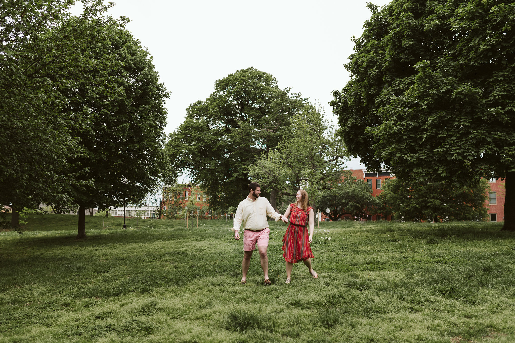 Engagement Photos, Patterson Park, Baltimore, Maryland Wedding Photographer, Casual, Fun, Nature, Couple Playing Together in a Field, Holding Hands