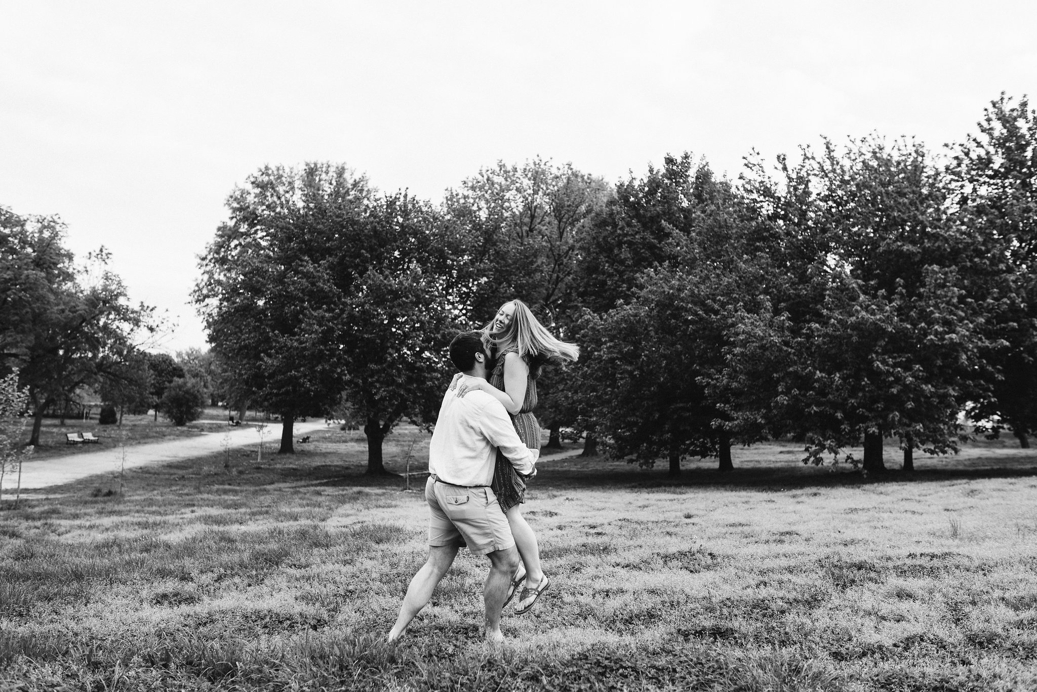Engagement Photos, Patterson Park, Baltimore, Maryland Wedding Photographer, Casual, Fun, Nature, Groom Picking Up Bride and Spinning, Black and White Photo