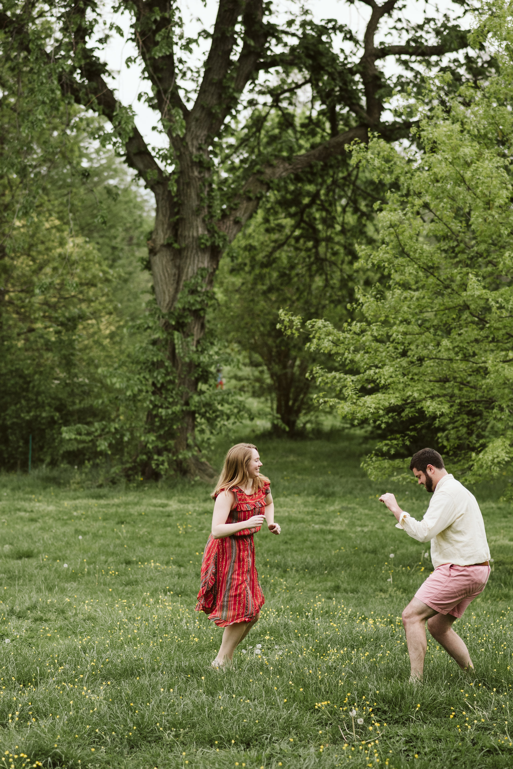 Engagement Photos, Patterson Park, Baltimore, Maryland Wedding Photographer, Casual, Fun, Nature, Couple Dancing Together in a Field