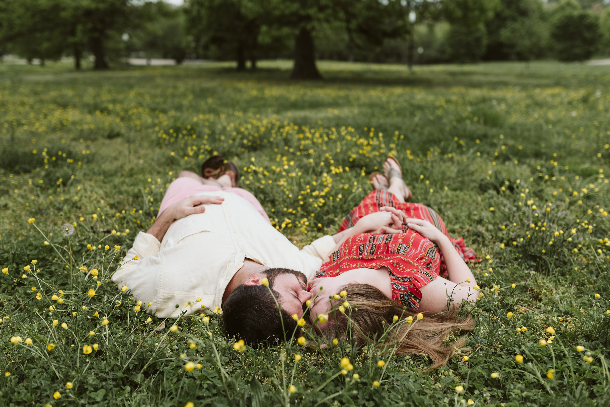 Engagement Photos, Patterson Park, Baltimore, Maryland Wedding Photographer, Casual, Fun, Nature, Bride and Groom Laying in the Grass, Buttercup Flowers