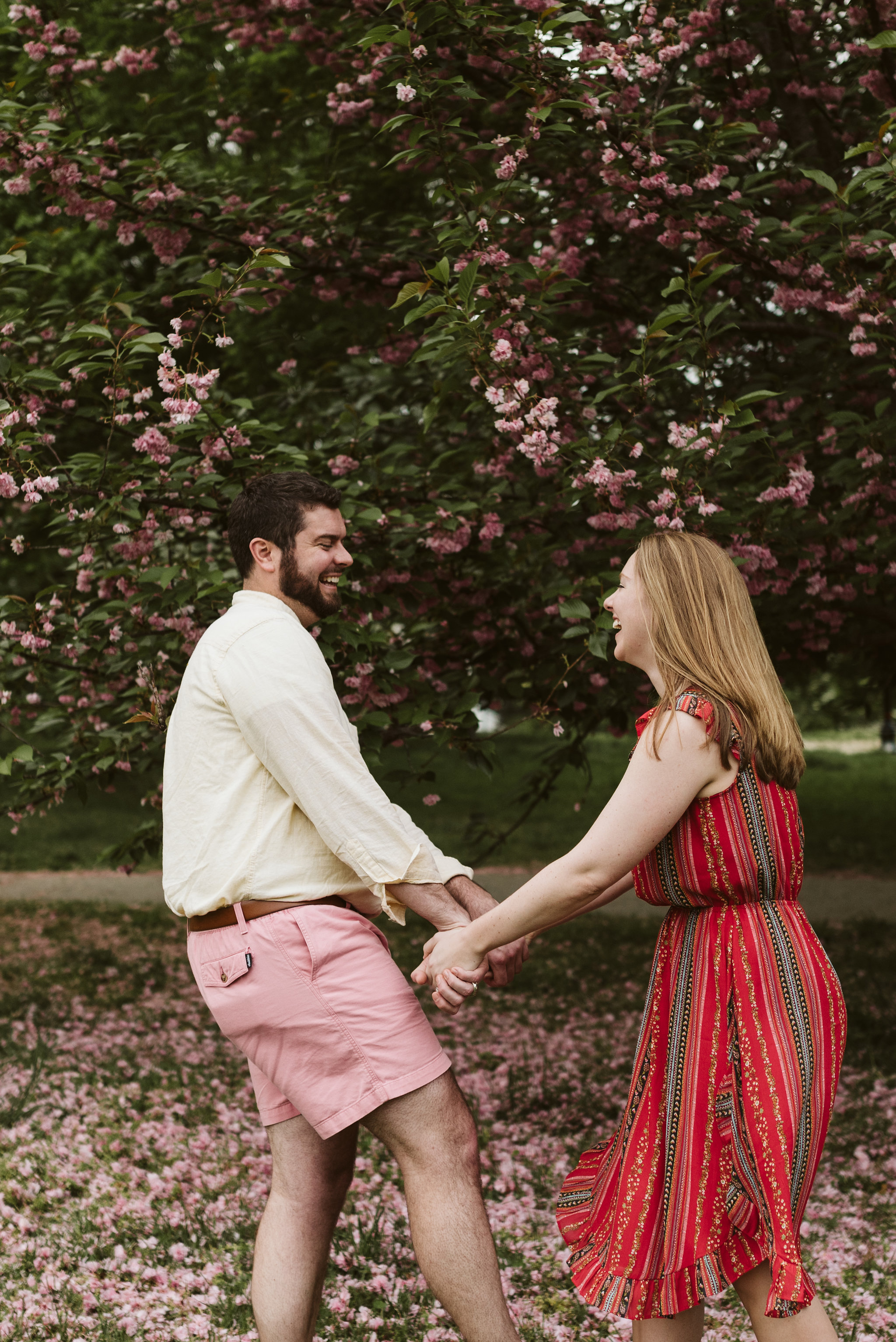 Engagement Photos, Patterson Park, Baltimore, Maryland Wedding Photographer, Casual, Fun, Nature, Bride and groom Holding Hands Under Crape Myrtle Tree