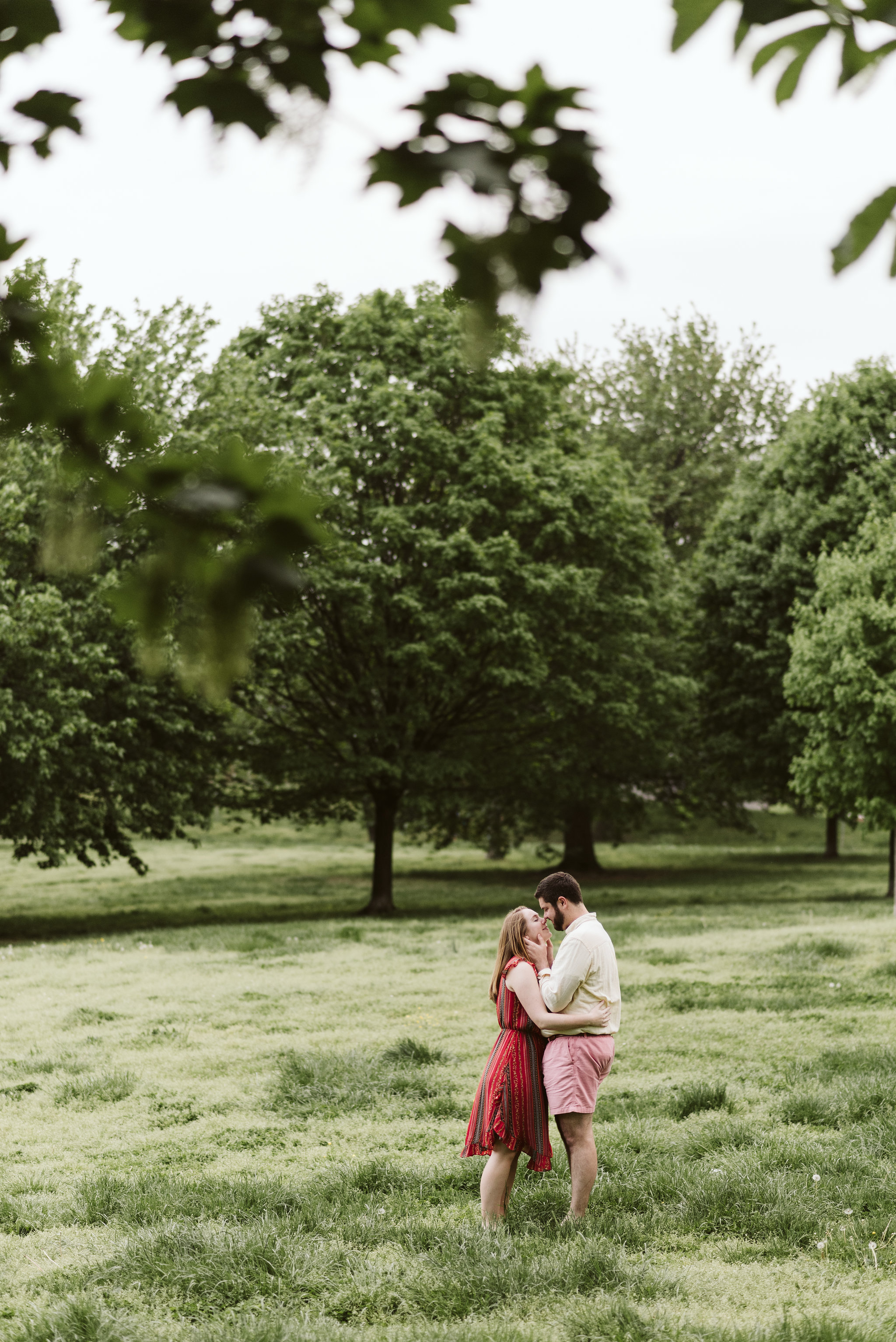 Engagement Photos, Patterson Park, Baltimore, Maryland Wedding Photographer, Casual, Fun, Nature, Bride and Groom Holding Each Other in a Field, Sweet Photo pf Couple