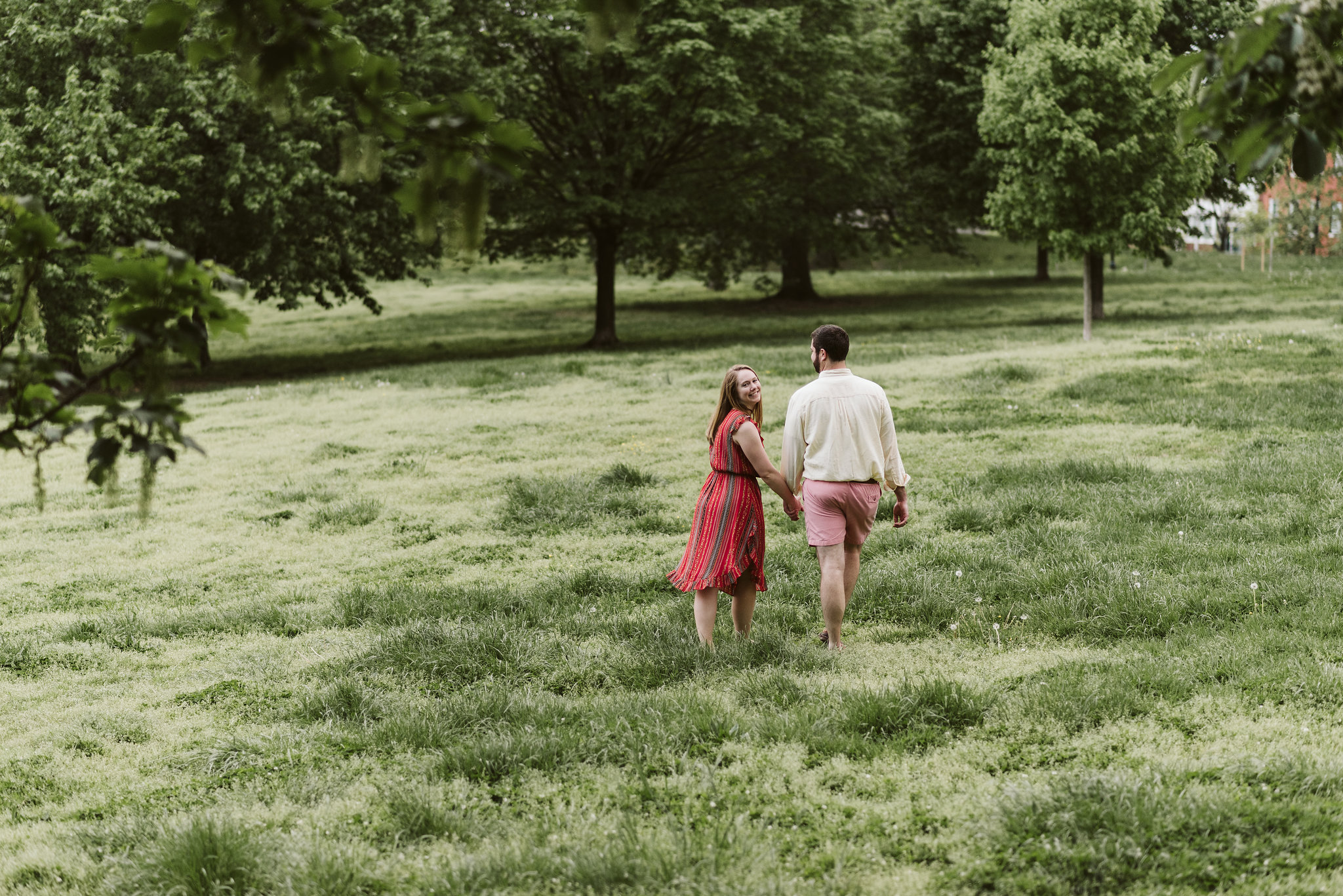 Engagement Photos, Patterson Park, Baltimore, Maryland Wedding Photographer, Casual, Fun, Nature, Bride and Groom Walking Through a Field Together, Holding Hands