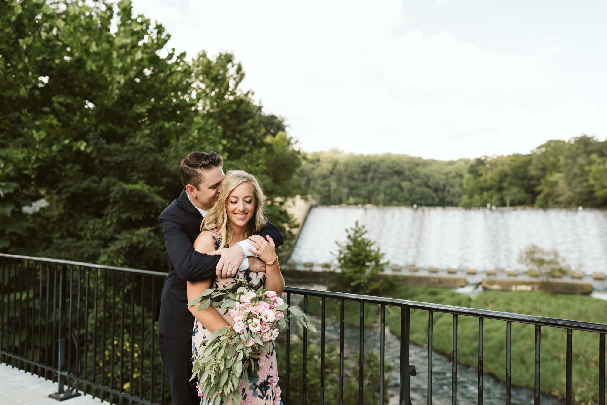 Outdoor Wedding, Casual, Simple, Lake Roland, Baltimore, Maryland Wedding Photographer, Laid Back, DIY Flowers, Bouquet with Eucalyptus and Lisianthus, Bride and Groom Hugging on Bridge