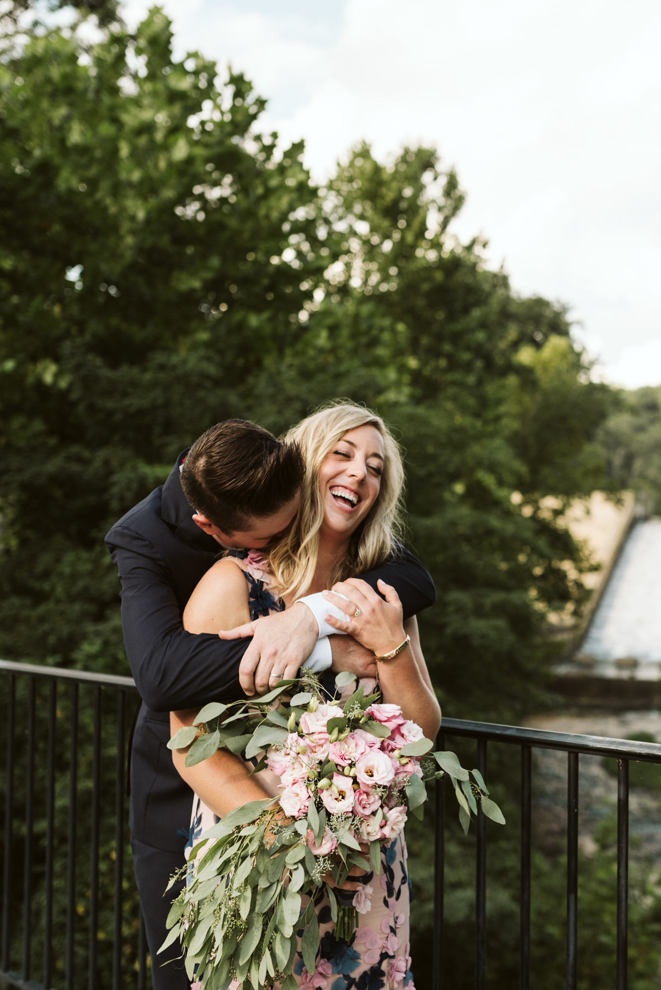 Outdoor Wedding, Casual, Simple, Lake Roland, Baltimore, Maryland Wedding Photographer, Laid Back, DIY Flowers, Bouquet with Eucalyptus and Lisianthus, Bride and Groom Hugging and Laughing