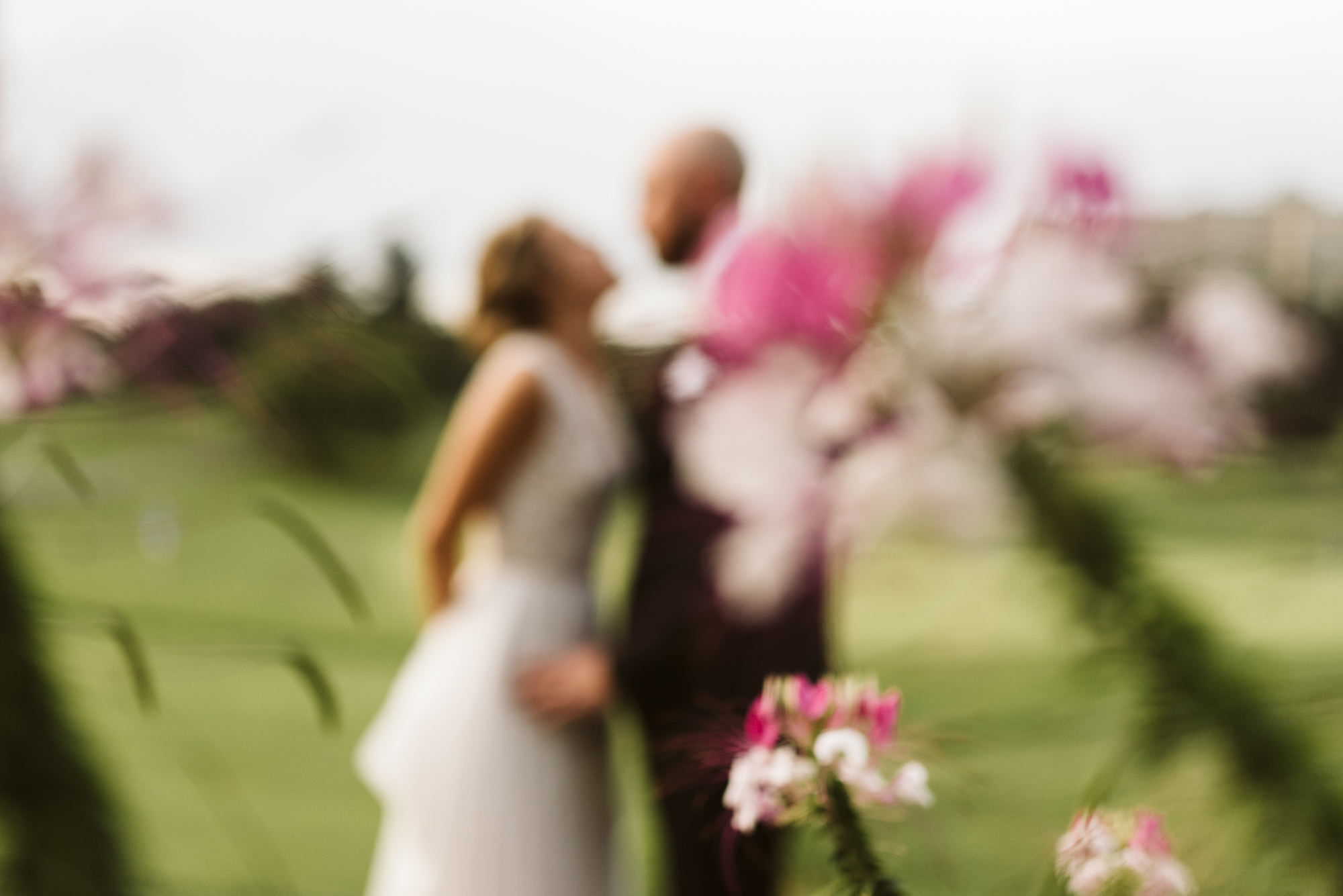 Elegant, Columbia Country Club, Chevy Chase Maryland, Baltimore Wedding Photographer, Bride and Groom Out of Focus with Pink and White Flowers