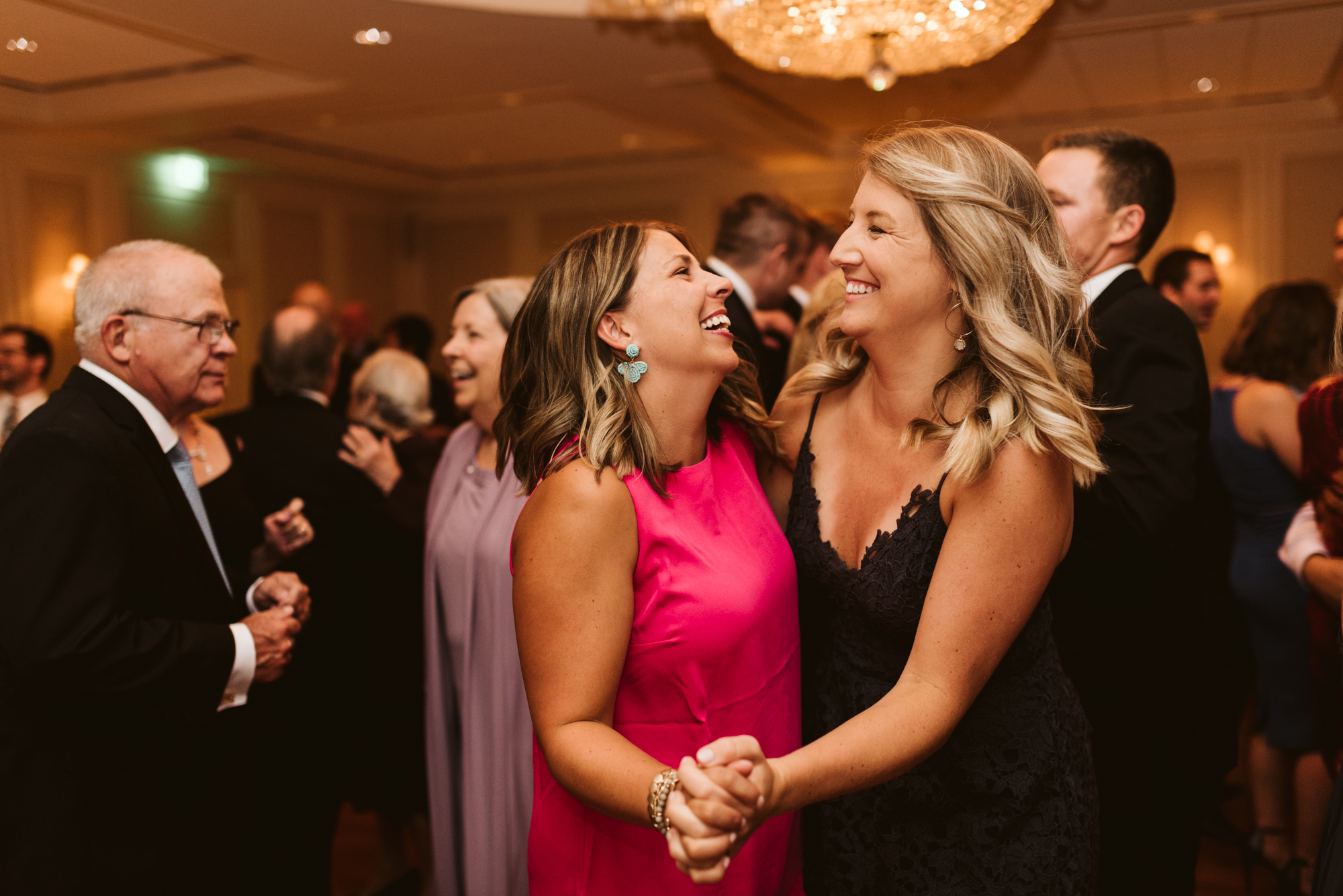 Elegant, Columbia Country Club, Chevy Chase Maryland, Baltimore Wedding Photographer, Classic, Traditional, Two Women Dancing at Wedding Reception, Wedding Guests Laughing on Dance Floor