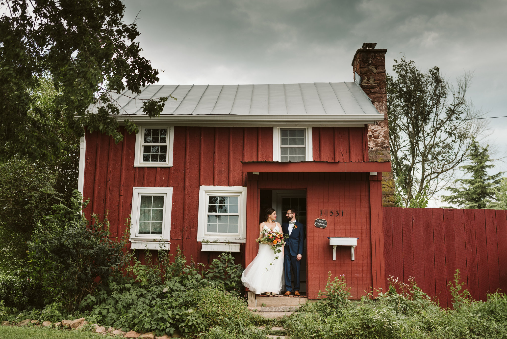 Rocklands Farm, Maryland, Intimate Wedding, Baltimore Wedding Photographer, Sungold Flower Co, Rustic, Romantic, Barn Wedding, Bride and Groom Standing in Doorway of Farmhouse