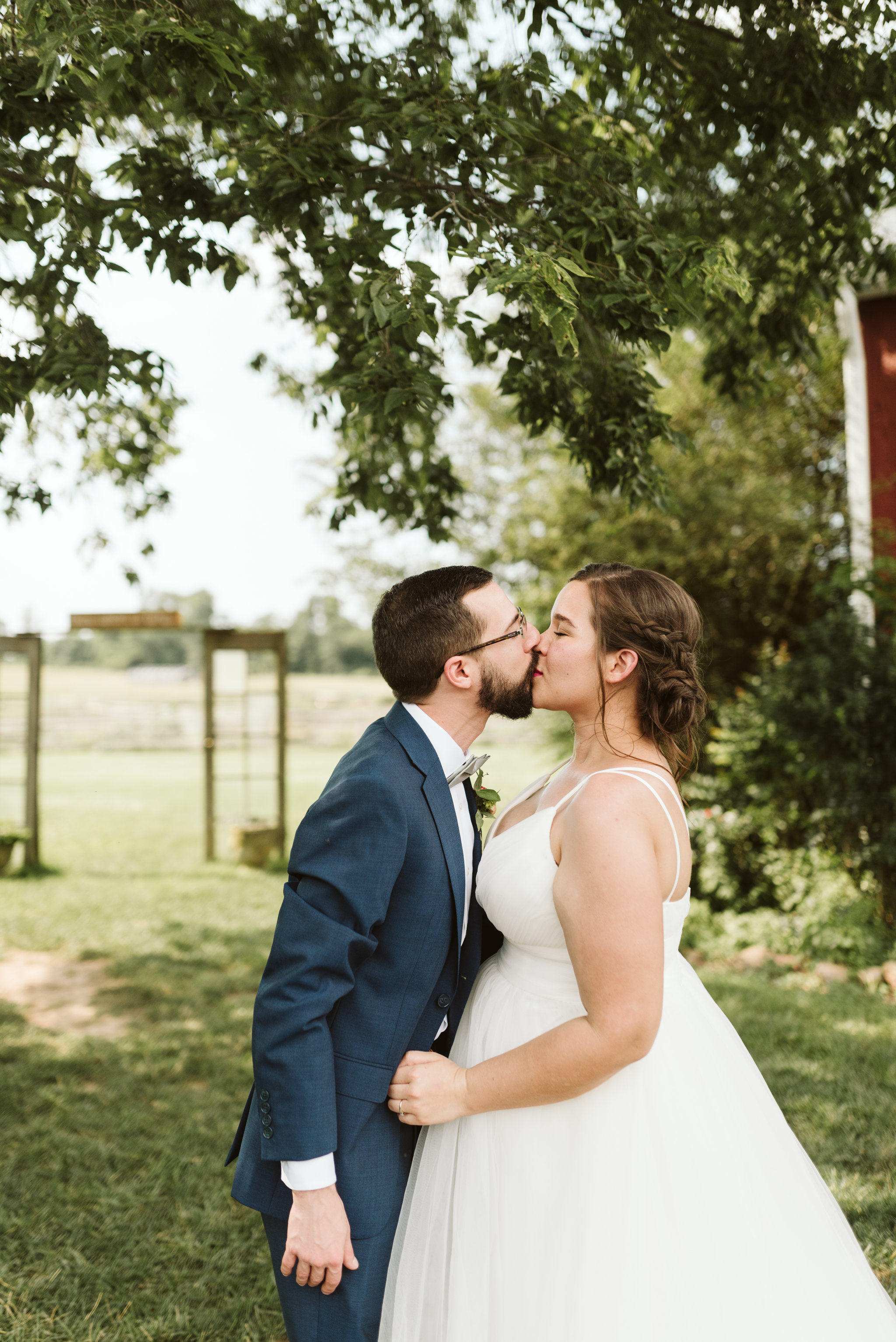 Rocklands Farm, Maryland, Intimate Wedding, Baltimore Wedding Photographer, Sungold Flower Co, Rustic, Romantic, Barn Wedding, Sweet Photo of Bride and Groom Kissing Outside